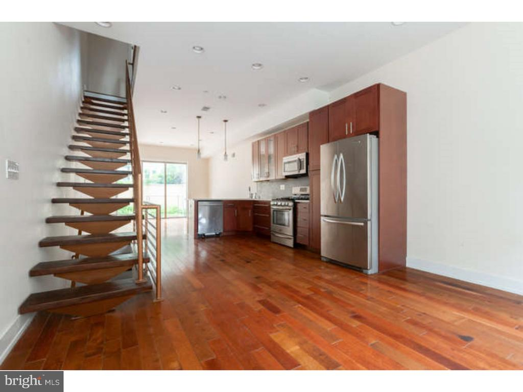 Great space and light in the HEART of Old Kensington! Newly constructed 3 bedroom, 2 1/2 bath residence boasts light filled living, and dining area with open kitchen. All over looking a dramatic back garden. Second floor boasts 2 very well proportioned bedrooms, and magnificent tile & marble bath. On the third floor you will find an enormous MASTER suite with 10 ft ceilings, and LUXURIOUS huge tile bath. Basement is finished with tile bath, and laundry. Extraordinary views from your private roof top deck. Space and value! Walking score 100!