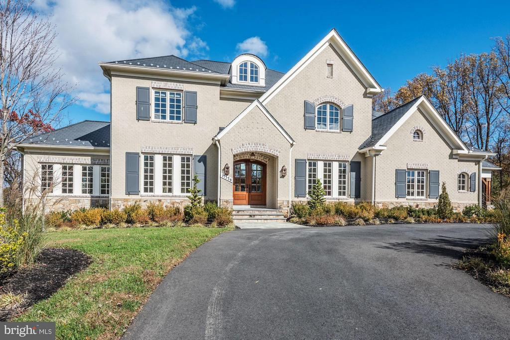 Open Sunday 3/17 1-3 PM** Large 200k Price Reduction*** This stunning 10,000 square foot Custom Estate Home was built by the builder in 2016 for his personal residence. There are 7 Bedrooms and 7 Full Baths to go along with 3 Half Baths on the 3 levels, all with Elevator service to each. From the exquisite use of Brick and Stone on the outside to the fine European touches in the interior, this home leaves nothing undone. The Gourmet Kitchen, with its gorgeous granite stone colors, features an office and a Baking pantry all opening up to large Family Room with coffered ceilings and built in entertainment system. Cozy up to the beautiful Stone Fireplace this winter an enjoy the atmosphere. The upper level features 5 bedrooms including the large Master Suite with a double-sided fireplace and sitting room, his and hers Walk in Closets and Master Bathroom with full body sprayers in the shower. The lower level has multiple spacious Recreation areas with double sided fireplace, a media room, Bar area with kitchen and 2 bedrooms along with a lower lever laundry. The walkout lower level takes you out to an incredible Backyard Pool, with Pavilion and outdoor fireplace and full Bathroom, multiple patios and waterfall features in the pool. The pool deck also features a large outdoor kitchen for entertainment.