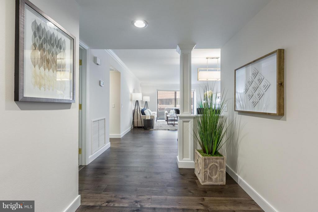 NEWLY UPDATED UNIT IN THE FLOURMILL CONDOMINIUM. SPACIOUS OPEN FLOOR PLAN, FRESHLY PAINTED,  WOOD FLOORS, UPDATED KITCHEN AND BATHS. POTOMAC RIVER VIEWS.