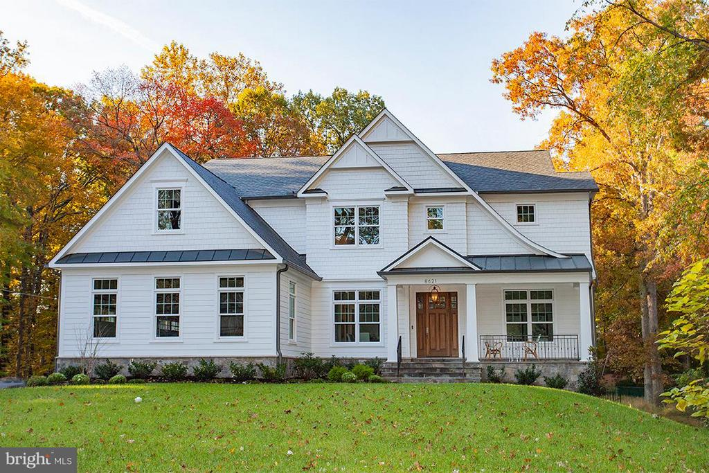 """Design & Craftsmanship at its best! Carrmichael is offering another Spectacular Home in Vienna! Ready for immediate delivery! .75 acres, 6,848 sqft, 6bed 6.5bath & 3 stall side load garage. Designer kit w/ 42"""" subz & 48"""" Wolf range. Custom Cabinetry + Field-Built pantry & mudroom. Main level bedroom suite. 6"""" White Oak floors. Master w/ custom his/her closets & Lux bath. Fin bsmt w/ bar & walkout"""