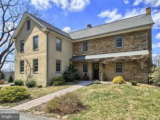 """Gentleman's Farm. Private Retreat. Sensational Renovated 1825 Stone Farmhouse with charming 900 square foot guest house situated on 87,1 acres to roam! Fields for crops, wooded areas and a meandering creek, wildlife turkey/fox/deer/migratory birds call this farm their home. A restored bank barn features new wood flooring, sides, roof and horse stalls. There are 29 acres tillable and with over 54 acres of forest, including a creek, this property is a natures paradise. Custom shaker style kitchen by """"Dexter Frey"""" with granite counters, breakfast bar and wide plank floors. Kitchen overlooks dining room and family room. Additional features include deep window sills, random width floors, walk-out lower level with kitchenette, 4 bedrooms, 3.5 baths. 7 heating zones and 2 central A/C zones. Located near Tucquan Glen Nature Preserve and near numerous nature preserves and the Susquehanna River."""