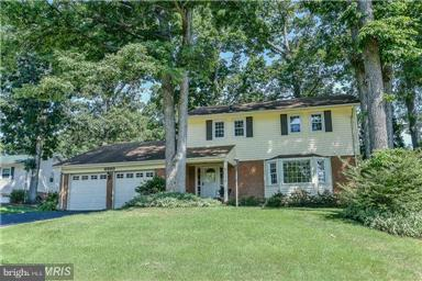 Beautiful 4BR 2.5BA colonial in sought after Cardinal Forest. Renovated large eat-in kitchen w/breakfast room lots of light! The spacious family room has built-in shelving, FP &walk-out to the backyard. Gleaming hardwood floors on main &upper levels. ! 2 car garage. Fenced back yard.