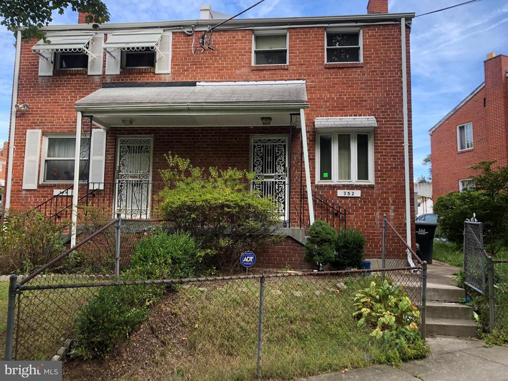 Two bedroom semi-attached brick home located in Fort Dupont Park. Features a finished basement with a half bath, Perfect for a separate office. Easily accessible to public transportation, highway 295 and Capitol Hill. Sold-As-Is, CASH or Conv w/REHAB. Thanks for showing.