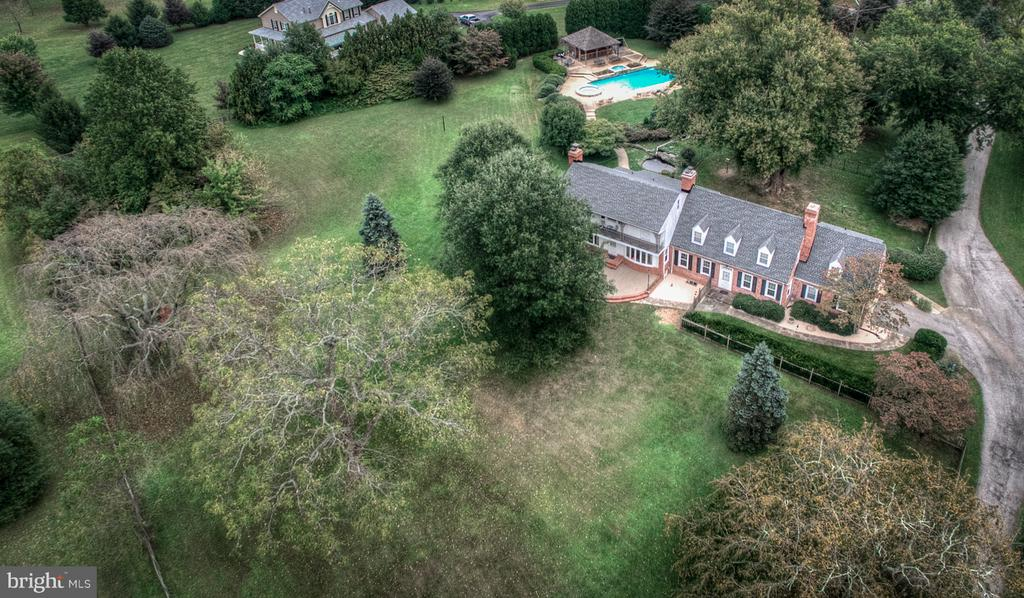 We just lowered the price by $25,000.00  Seller said sell it, sell it   Over 9+ Acres high atop the Gunpowder. Private 6000 sqft Traditional Colonial Manor with 2 acres of fenced yard,Resort Style pool entertainment area. Let yourself get lost in this home with its Tavern Room. 33x33 Great Room with Wet bar, Open living, Family, Kitchen area or retire to your 650sqft Master Suite with adjoining Private Dressing Room. Preliminary plans reviewed by county for Subdivision.