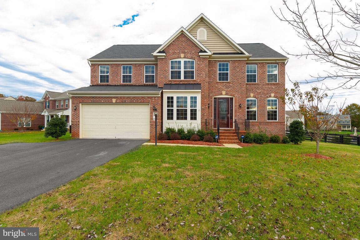 """Rare Offering in Hunter Ridge on .48 acres! Upgrades Galore! Gleaming Hardwoods on main and upper level! Gourmet Kitchen w/morning room! Granite island, 42"""" cabs, SS. Fam Rm w/ stone gas FP! Main level Lib. Lux Mstr Suite w/ FP and Lux bath! Custom plantation shutters! Full Fin Basement w/ theater room. Chairs, screen, and projector convey.  Wet Bar in LL.NEW ROOF! Trex deck and inground spr sys."""