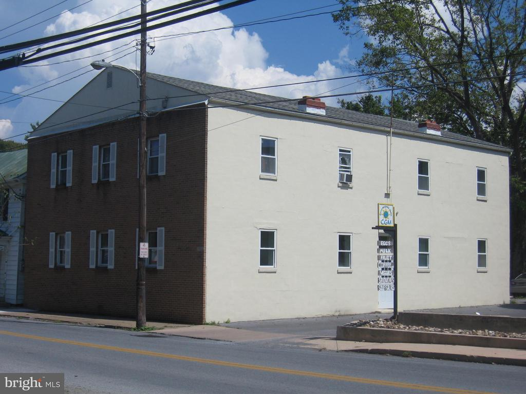 Investment Opportunity! Historic downtown Shepherdstown. Four spacious apartments with parking in rear for up to 15 cars. Circa 1965, all wood flooring, fireplaces. Walk to campus/grocery/convenience store/restaurants and more. 4408 sq, ft, Building was originally built for cold storage.