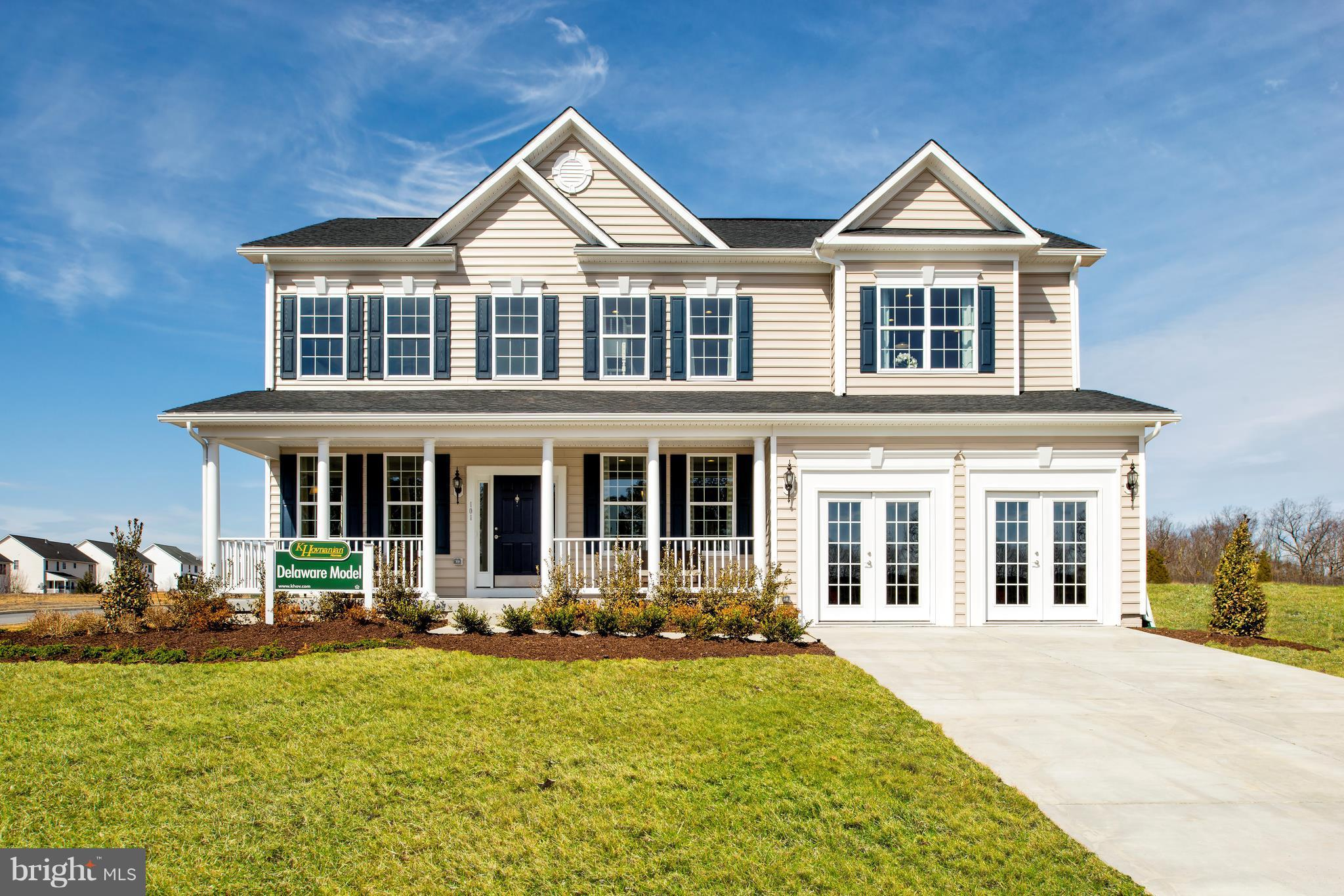 Spacious floorplan with soaring two-story family room; optional spa shower and gourmet kitchen. Photos similar; may show options.