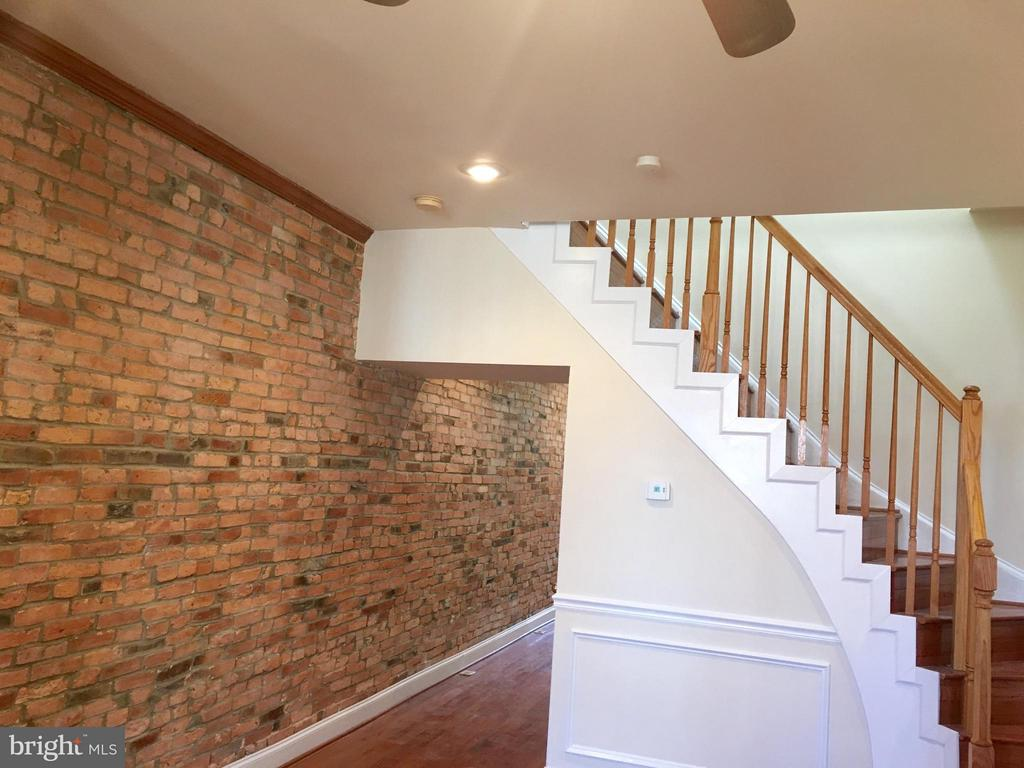 UPDATED $3,000  CLOSING ASSISTANCE. This is a renovated home with hardwood flooring, crown molding, carpet in bedrooms, brick wall in dining room, and ceramic tile in the bathroom,and large rooms.
