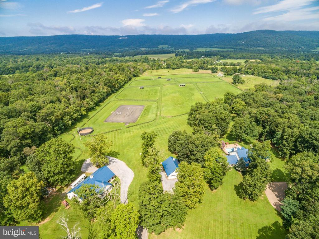 Unique 94  Acre Horse Property in Piedmont Hunt Country territory. 8 stall center aisle Barn;4 stall 2nd Barn;11 Paddocks;Run-ins; 150' x 200' Arena! Updated,open  4+ Bedrm  country house with beautiful vistas & mountain views; Pool+  Hot Tub; Fire pit + Built in Grill; 2 car detached Garage+1 BdRm/Office Guest House; 2 Bedrm Log Cabin. VeryPrivate but minutes to Middleburg /Uppervile ,Rt 50 &  7.