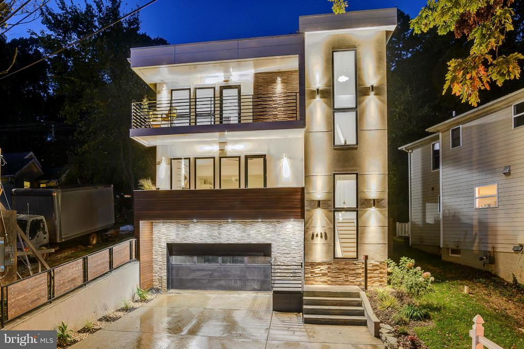 """** SHOWINGS BY APPOINTMENT ONLY ** CALL TODAY TO SCHEDULE YOUR VIEWING (APPT: 240-274-2100) ~ """"European-Boutique-Contemporary-Villa"""" Nestled within a Secluded Neighborhood. This Modern Masterpiece features 3386 sq. ft. of Luxurious Living on an Open Floor Plan, which incorporates Modern Design with  Exotic Wood Species inside and out. Truly one of a kind! Step inside the home and find a Main Level Suite/Bedroom, fully equipped with a Full Bathroom and Custom Kitchenette - perfect for guests, in-laws, au-pairs, and more. Upstairs, find an Open Concept Entertainment/Living space which features a Designer Two Tone Kitchen - outfitted with Acrylic Custom Built Cabinetry, Communal Table, Top of the Line Appliances, Wide Plank Hardwood Floors, Stone Clad Gas Fireplace, and a Powder Room. One more level up and you will find the """"Light & Bright"""" Luxury Master-Suite including a Walk-In Closet with Built-Ins, Spectacular Bathroom with a Soaking Tub and Shower, Balcony facing the Canal, in addition to 3 more Bedrooms/Suites, each with an In-Suite Bathroom and Closet. This level also features a Washer/Dryer, conveniently located in the Central Area of the Level. Step outside the rear of the home to find the Meticulously Built Two-Tier Patio, which has a Custom Crafted Cabana, Wood Burning Fireplace, and not to mention Extensive Greenery/Landscaping - perfect for entertaining guests! The yard is Fully Fenced and Enclosed, in addition to having a Storage Shed. The home is situated within a Perfect Location, inside the heart of Cabin John, boasting Gorgeous Views and Nature while being ideal for commuting to D.C. & VA as it is minutes away from all major highways. All of this plus a 2-Car Garage, Paved Driveway with rough-in for Gated Entry, and a Washer/Dryer on entry level (catered to the main level suite). Schedule your private tour today."""