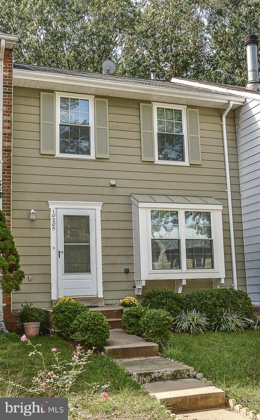 Updated from top to bottom! Wood flrs thruout main lvl, stairs & upper hall. Remodeled Eat-in Kitchen w/granite, SS appls & breakfast area. Liv Rm w/wood burning FP. Sep Dining Rm steps out to fenced yard & deck w/wooded views! Master w/2 large closets & priv access to full bth. New Carpet in Bedrms. Updated bths! LL Rec Rm w/full bth & extra storage! Mins to VRE! Tons of Community Amenities!