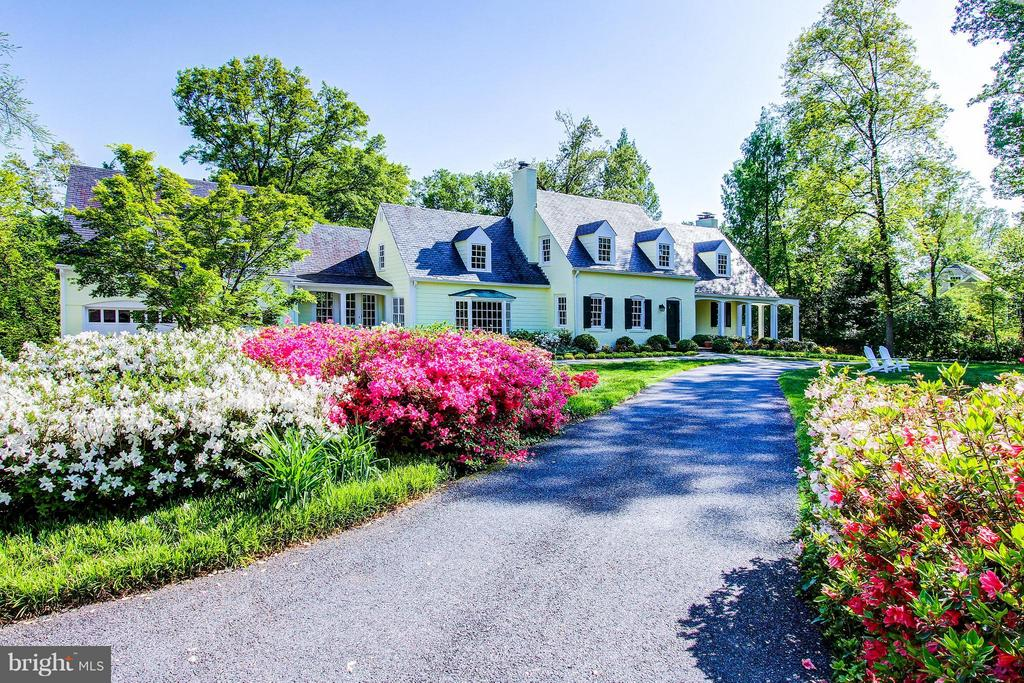 See DRONE VIDEO with Aerial view of 1.4 ACRES close in-Bethesda. Goto: 6620ElginLane.   Lush and expansive, close-in, 1.4 Acre property on the most charming street of Elgin Lane.  This elegant setting, on a one-of-a-kind property, sits back from the street, boasting of mature landscaping that surrounds the perimeter of the property creating a natural border for absolute privacy.  This is the ideal home for entertainment and family gatherings.  With only 2 owners in 50 years, the current owner recently made loving and extensive renovations and additions to the home that preserved its original charm while incorporating modern functionality and numerous unique features. The galleries located on both the Main and Lower Levels have a wall of French doors that expand the length of the home and exit out to balconies and patios showcasing the large backyard, superb gardens, and bright Southern exposure. Gracious and comfortable, this home~s open and sprawling floor plan effortlessly blend formal and casual living, creating a perfect setting for warm and lasting memories. The bright and sunny gourmet Kitchen with its wall of windows also overlooks and exits out to the backyard.  The Kitchen is flanked by the Family Room, banquet sized Dining Room, and spacious Mudroom with 2nd entrance, where there is easy access to the oversized 2 Car Garage.  There are 4 bedrooms, 5 full bathrooms and 1 Powder Room on 3 finished levels.  A fully finished Lower Level offers a casual Media Room and another Family Room.  The exterior of the home features a circular driveway which ties into the flagstone walkway that leads to the front door, covered Portico, and gracious steps along both sides of the property leading to the backyard and enormous rear Patio.  With two front covered Porches, one that leads into the Mudroom~s 2nd entry and another with roomy wrap-around views of the lovely front, side and backyard~ this home is a lovely retreat and haven. Enjoy endless sporting activities with easy access to the Canal and Tow Path where there is biking, jogging, hiking, paddle boarding, kayaking, and canoeing.  Located so close to DC via Massachusetts Ave, Clara Barton Pkwy, GW Pkwy, and McArthur Blvd with easy access to Virginia as well as ALL airports !Add~l Features include random width hardwood floors, Buckingham Slate roof, 4 fireplaces, an oversized 2 Car Garage, Southwest Greens designed Putting Green, lawn irrigation system, optional neighborhood Swimming Pool Membership to Merrimack Park Pool, dedicated storage rooms and a charming storage shed.