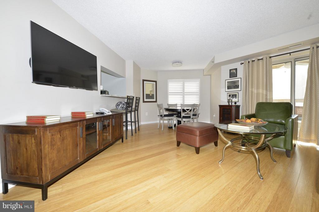 1 BR, 1 BA has DR area, kit table area, W/D & encl balcony (not incl in 728 sqft), which creates a bright, light, warm home. Enjoy the 12th floor views. Rent incl garage & storage. Just pay electric, phone & cable. Enjoy Carlyle's pool, 2 gyms, tennis, putting green, 24-hr security, etc. Blocks to metro, PTO, shops, movies, restaurants & Whole Foods.