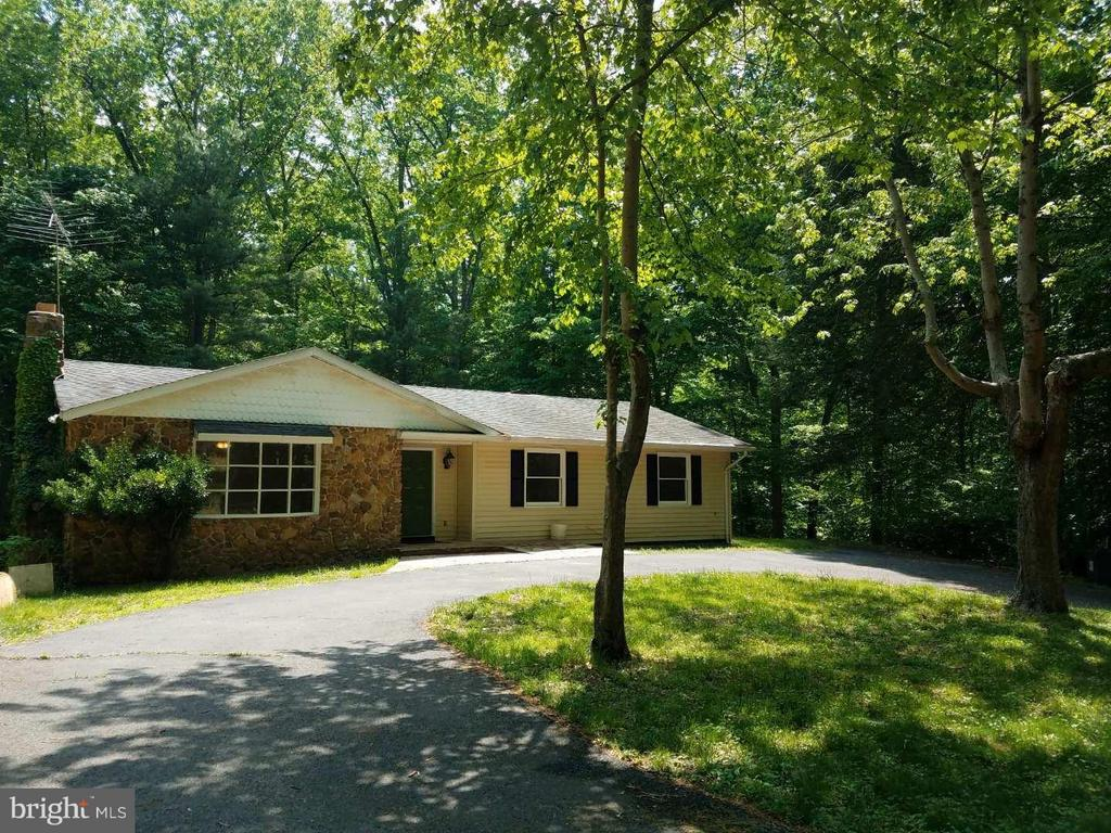 For nature lovers. One-level living located on almost 6 private acres of of mature woods, abutting a perennial stream. Florida room overlooks the woods and connects both the master BR and main living area. Lower level offers a partially finished in-law suite w/private access, a kitchen, LR, BR& FB. Circular driveway, Conveniently located close to VRE, PW Pkw, 28, but feels like a nature retreat. No HOA!