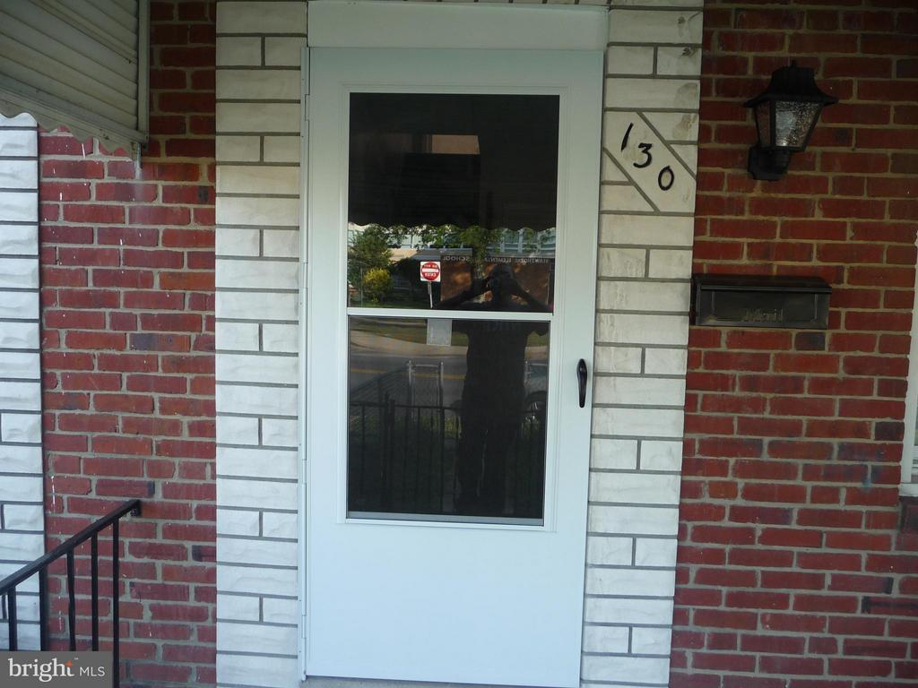 PRICE REDUCED!!! Brick townhome near park and water available for immediate move in. Living room, separate dining room, updated kitchen with stainless steel fridge. Gleaming hardwood floors and new roof in 2016. Central air plus washer/dryer included. Enjoy nice room sizes. Fenced front and back yard. Additional finished area in the basement can be used as a family/rec room. Convenient Middle River location.
