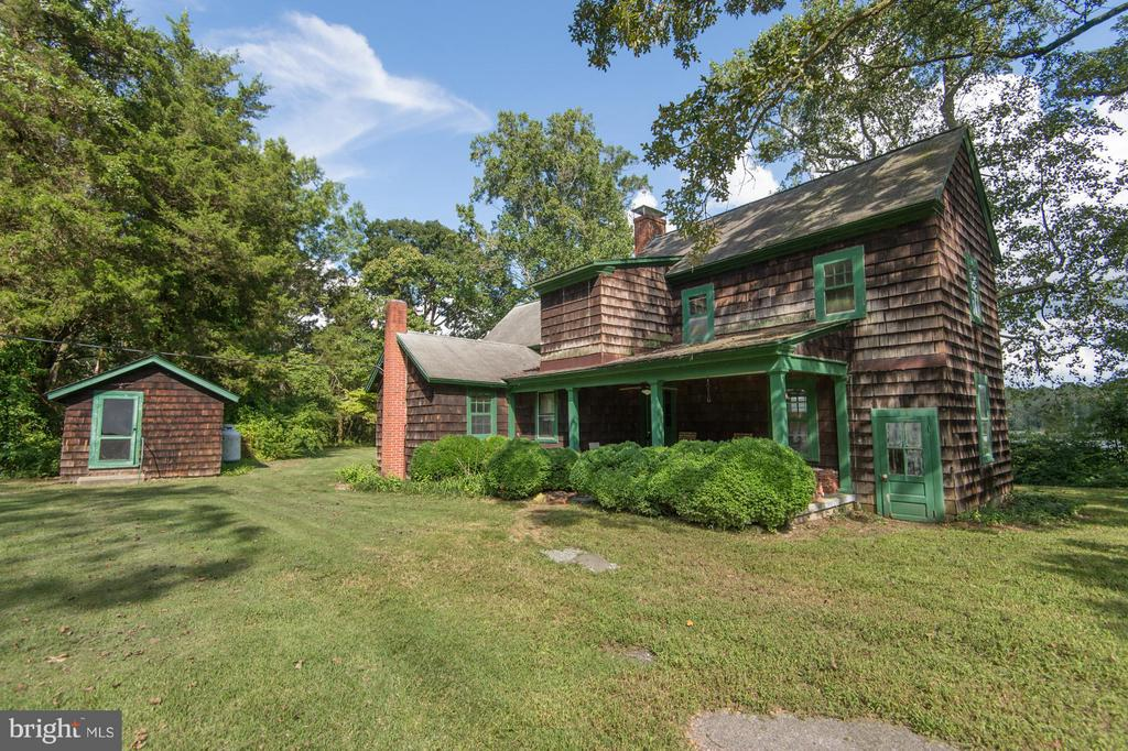 Waterfront retreat! 17+ acres on the shores of the Marshyhope Creek.  This property is surrounded by mature trees, improved with a 3 bedroom, 2 bath farm house and several outbuildings. Front and rear porches to enjoy the view. Horses allowed - fenced pasture and run-in.