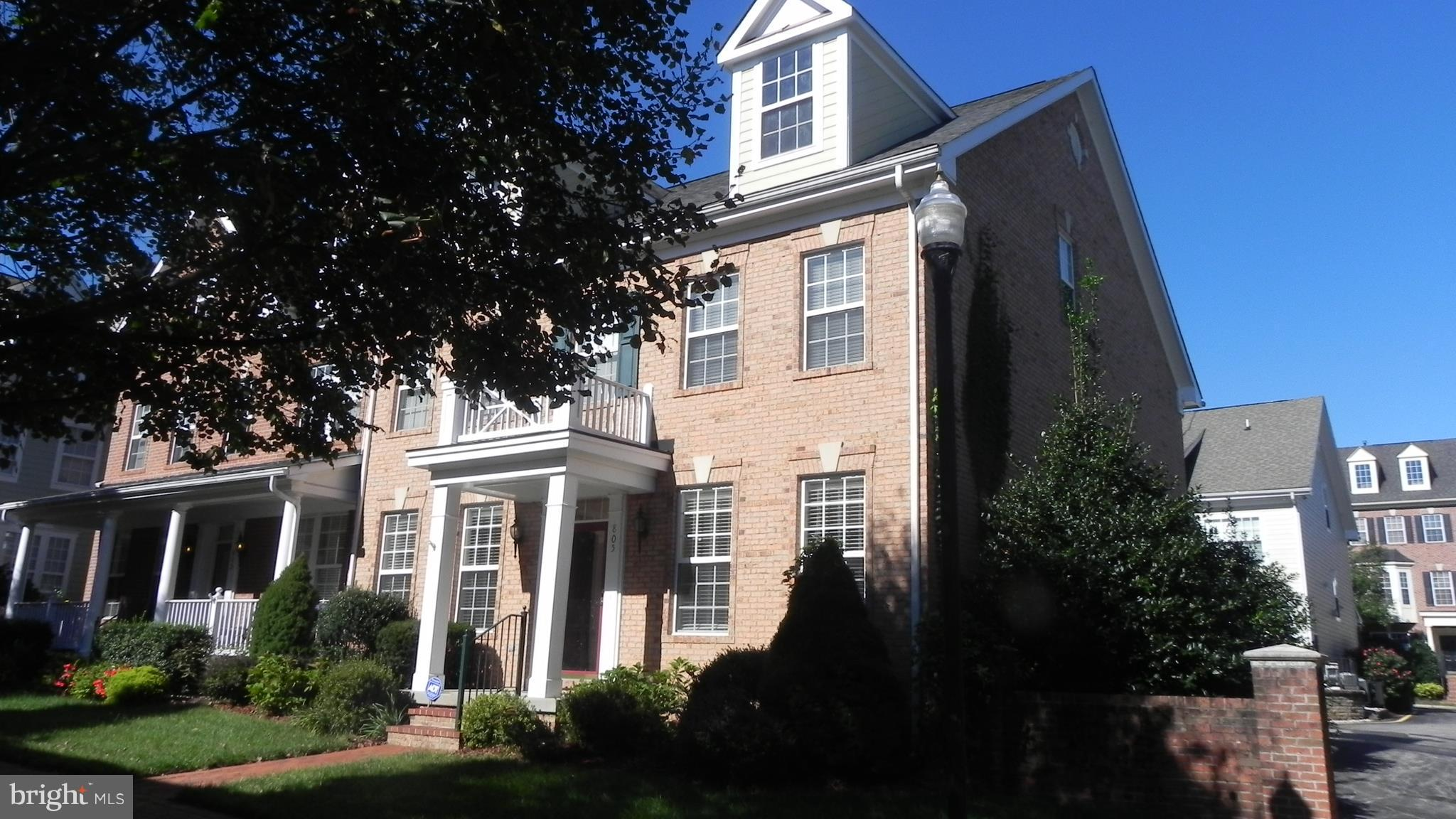 Huge, light filled, end unit townhome on the square in Beautiful Belmont Bay.  Location is optimal with commuter lots close, VRE within 1 mile and shopping.  When you are home, enjoy the walking trail along the water or the nature preserve.  Granite countertops in kitchen, spectacular owner's suite with sitting room, double vanities, soaking tub and upgraded tile.  3rd level princess suite.