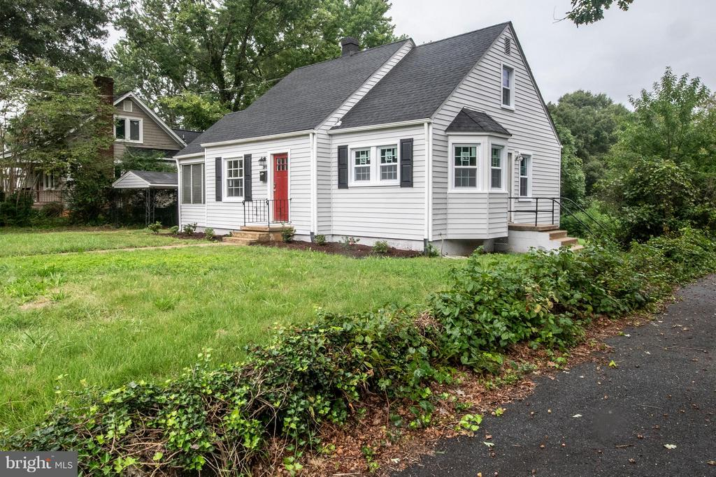 Cute as a button Cape Cod in a tucked away pocket that is minutes from downtown, I-95 & endless shopping locations. This property has received tons of updating touches to include,but not limited to:New paint, new laminate flooring, new carpet, fixtures, marble flooring, windows,SS appliances,roof,& lighting.Upper level can be utilized as a third bedroom,living area or play area. Endless options!