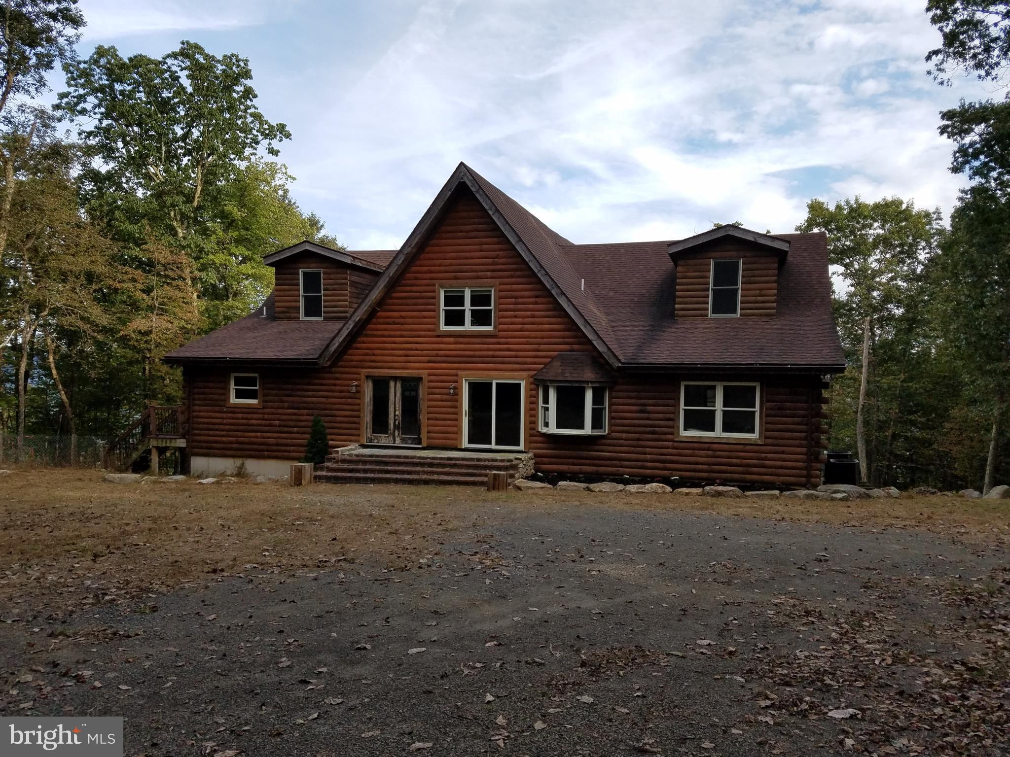 PRIVATE MT TOP RETREAT..surrounded by 64 acres with a 4000 sq ft log home, spacious great rm w/cathedral ceilings, maple kitchen cabinets, custom island/bar, spacious master bath w/claw foot tub, double sinks, huge deck for entertaining, mud/pet room, full walkout basement, 40x24 shop.
