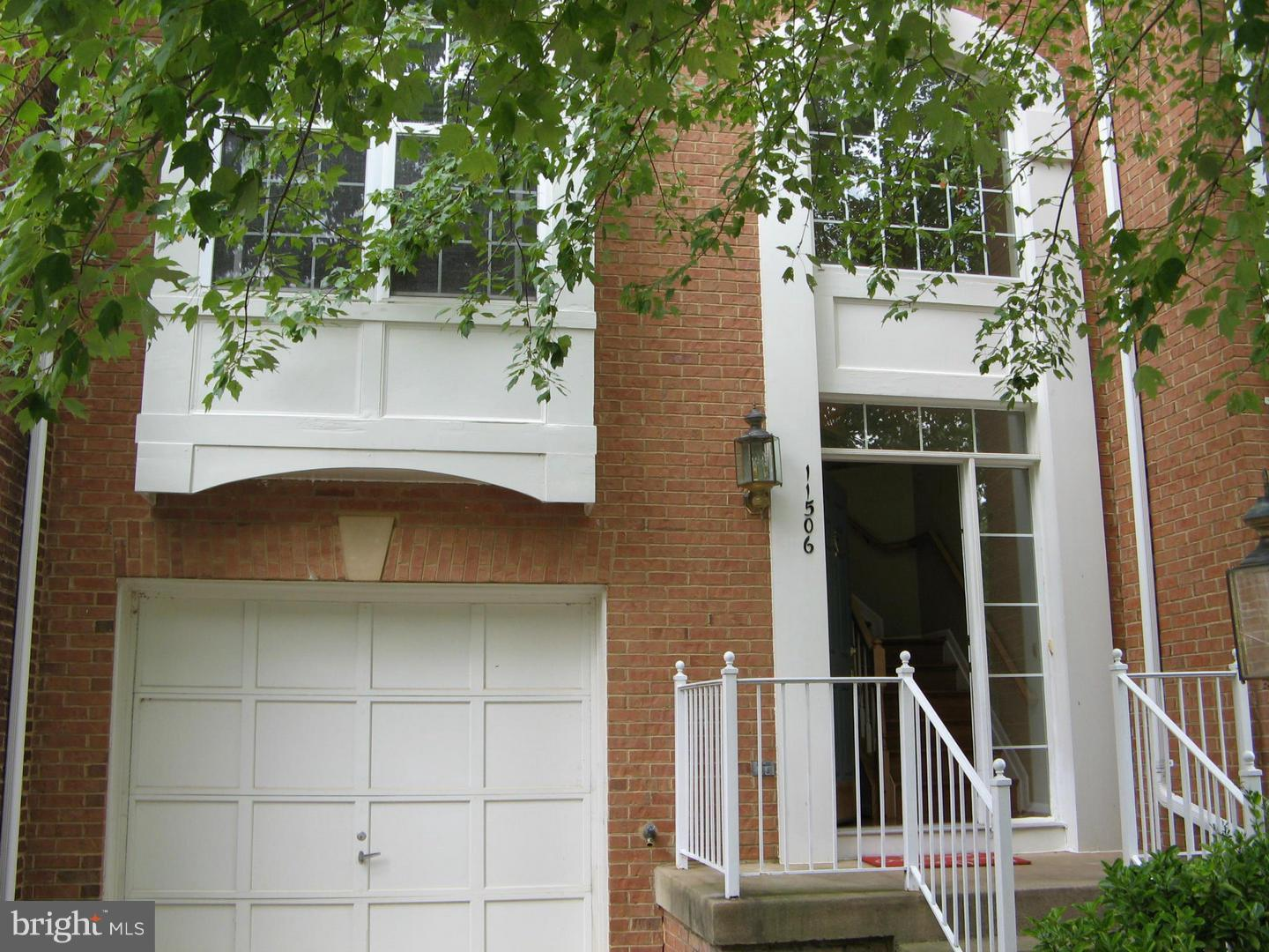 "ELEGANT BRICK FRONT GARAGE TOWNHOME IN NORTH RESTON offering 3 beautiful finished levels "" BUMP OUT"". 2 story foyer+9' ceiling on main floor. Spacious kitchen with Breakfast room next to family room. Gas fireplace, Hardwood floor. Wonderful master suite with cathedral ceiling, Walk-in closet and luxury bath with two person tub and separate shower. Large walkout basement with den."