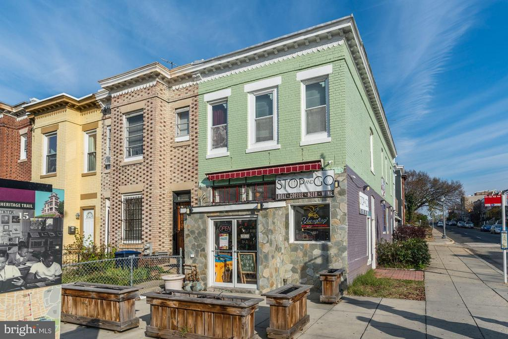 REDUCED AND READY TO SELL! Unbeatable location in heart of Columbia Heights, at busy intersection just blocks from the booming U St corridor. The upstairs has a 2 bedroom 1 bath apartment that can easily become your home while you rent the retail, or vice versa. Between the lot, location, 43 foot frontage with OUTDOOR space, and the 3 block walk to Columbia Heights metro, & foot traffic, this is the best retail/residential opportunity in NW DC! Don't miss out. Think trendy cafe, upscale wine bar, farm to table deli, and MUCH more! The possibilities are endless with some minor build outs!