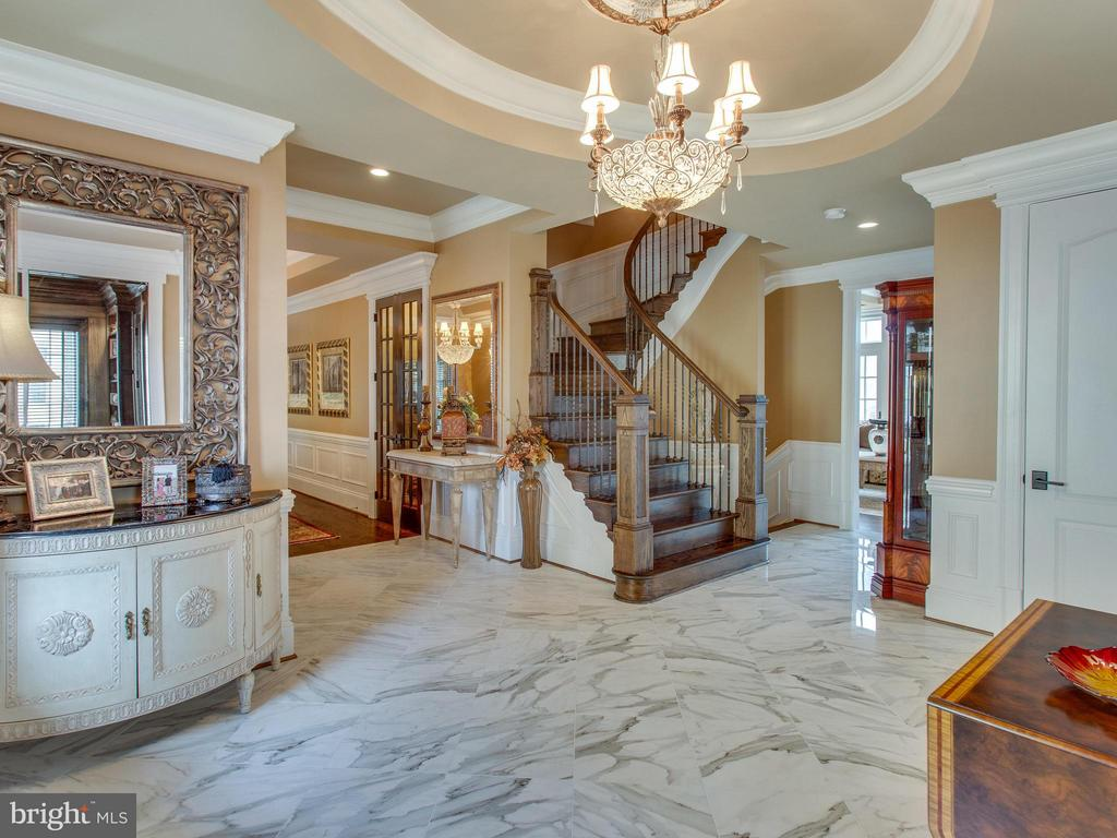 Stunning custom French Provincial home minutes from DC on tranquil hilltop cul-de-sac. This stately residence features over 6,035 square feet of finished living space  with 5 bedrooms, 5.5 baths & elevator. Main level offers endless space to entertain & true chef's kitchen. Spacious owner's suite features private deck & spa-like master bath with steam shower. Lower level boasts custom indoor/outdoor walnut bar, guest suite & entertainment-sized patio.