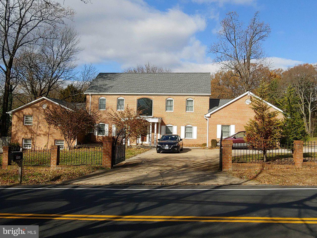 Large Brick Home on almost an Acre in Alexandria...Almost 4500 square feet on main and upper levels plus finished basement...Enclosed Porch and Deck/Gazebo on Peaceful Site...Room for multiple cars with the Large Circular Driveway and Parking Pad ..Home is currently configured for multi-family living and shown by appointment only