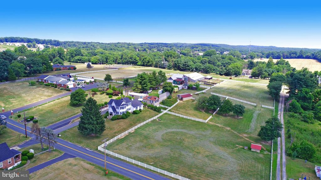 PROPERTY ZONED DR-2, GREAT FOR DEVELOPMENT. COLONIAL LOCATED ON OVER 8 ACRES WITH HORSE FARM!  HUGE BARN WITH 17 HORSE STALLS, SEVERAL OUT BUILDINGS, RIDING RING, SEVERAL PASTURES. KEEP AS A FARM OR SEPARATE AND SUBDIVIDE. GREAT OPPORTUNITY FOR BUILDERS!