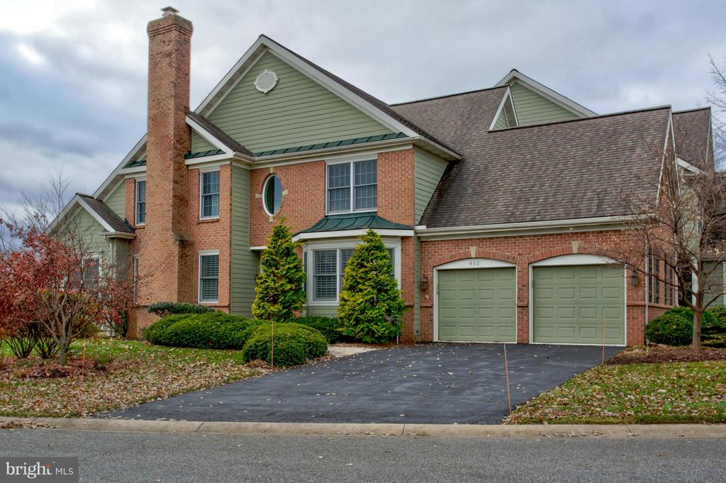 This fantastic Bent Creek home offers carefree living,  bright open floor plan with lots of beautiful hardwood flooring, 1st floor master bedroom with luxury bath featuring a fabulous walk in shower, gourmet kitchen with large island, 2 spacious bedrooms and bath on 2nd floor, wonderful bonus room which could be an office or 4th bedroom, 2 patios, 2 car garage and so much more.