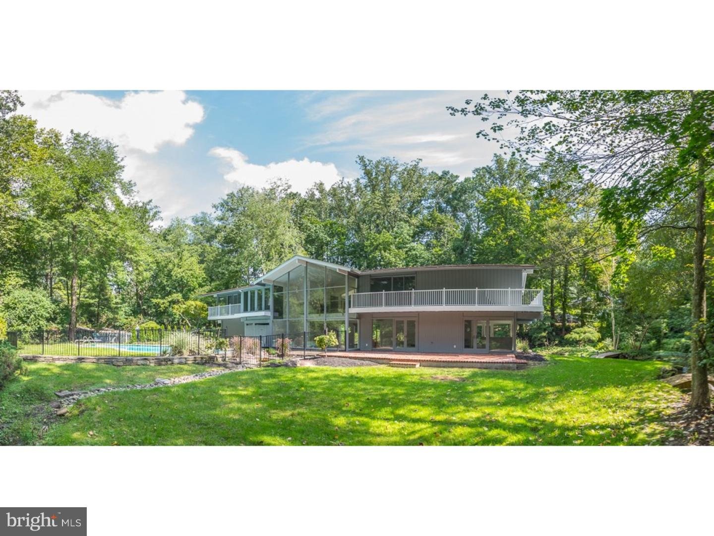 Island oasis in the outskirts of Gladwyne,  Enjoy the privacy away from civilization with all the comforts of a summer home,  pool, streams and your own fishing pond.  Live like there's no tomorrow today.  Welcome to 713 Waverly Road in Bryn Mawr. Newly renovated from top to bottom, this stunning contemporary home features 4 bedrooms, 2 full bathrooms, 1 powder room and over 3,500 square feet of fabulous living space. This home showcases views of the entire property with floor to ceiling windows that blur the line between indoors and out. The open floor plan and seamless indoor-outdoor integration is perfect for entertaining friends and family. The main floor includes beautiful Brazilian Cherry wood floors, a dining room, family room, and living room with wood burning fireplace that opens up to the expansive outdoors surrounded by lush trees, beautiful landscaping and a stream. The eat-in chef's kitchen has beautiful premium Quartz countertops, custom cabinets, stainless steel appliances and a large walk in pantry. A powder room, laundry room and access to the 2-car garage complete the first floor. The floating wood staircase leads you to the upper level which includes a second family room with wood burning fireplace and White Oak hardwood floors. A luxurious master suite, with sweeping views of the backyard, includes a large walk in closet and glass sliding doors that open to a private balcony. The beautiful master bathroom has a double vanity, glass enclosed shower, soaking tub and large glass windows. Three sizable bedrooms, all with sliding glass doors that lead to balconies, a hall bathroom and linen closet complete the second floor. The private backyard is an outdoor enthusiasts dream. A brick patio overlooks a beautiful fenced in pool, lush gardens, creek with two bridges and lots of greenery. This ideal location is minutes to 476, 76 and Center City all while in the award-winning Lower Merion School District.