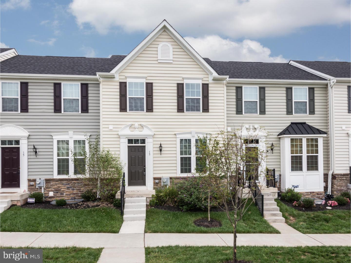 Motivated, Relocating Seller! YOU can own this home for 6K less than same model that was recently sold and get more upgrades! Transferrable 3.5% interest rate VA Loan if qualified! Welcome to this impressive 1-year young,like new town home in award winning Owen J Roberts Schools. Sought after Mozart Model in Washington Square has practically every upgrade possible that you will have to see in person to truly appreciate the over 40K in builder & owner upgrades which includes the lot premium! Walk in to the front door and walk directly into the very spacious, open concept living room, kitchen & dining area with beautiful hardwood floors. The Kitchen features granite counters ,custom tile backsplash, upgraded appliances, cabinets, & fixtures. The oversized island is the perfect touch to combine the kitchen with the dining room.  20x10 no maintenance trex deck, is set back from the adjoining homes for added privacy. Powder Room on this level rounds off this floor for added daily convenience. The upper level features the master suite with large walk in closet. The master bath includes an oversized custom tile shower with glass tile accent, granite counter w/ double sink & gorgeous tile floors. The washer/dryer are placed perfectly in the hall between the 2nd & 3rd bedroom, which are both spacious w/ ample closet space & both overlook the park-like square out front. Lower level you will find the finished basement with 2 walk in closets for added storage.Direct access to the oversized 2-car garage w/ added parking. Great Location-conveniently located close to highways, shopping & restaurants. Minutes from downtown Phoenixville, Valley Forge, KoP, Phila Premium Outlets & Providence Town Center.