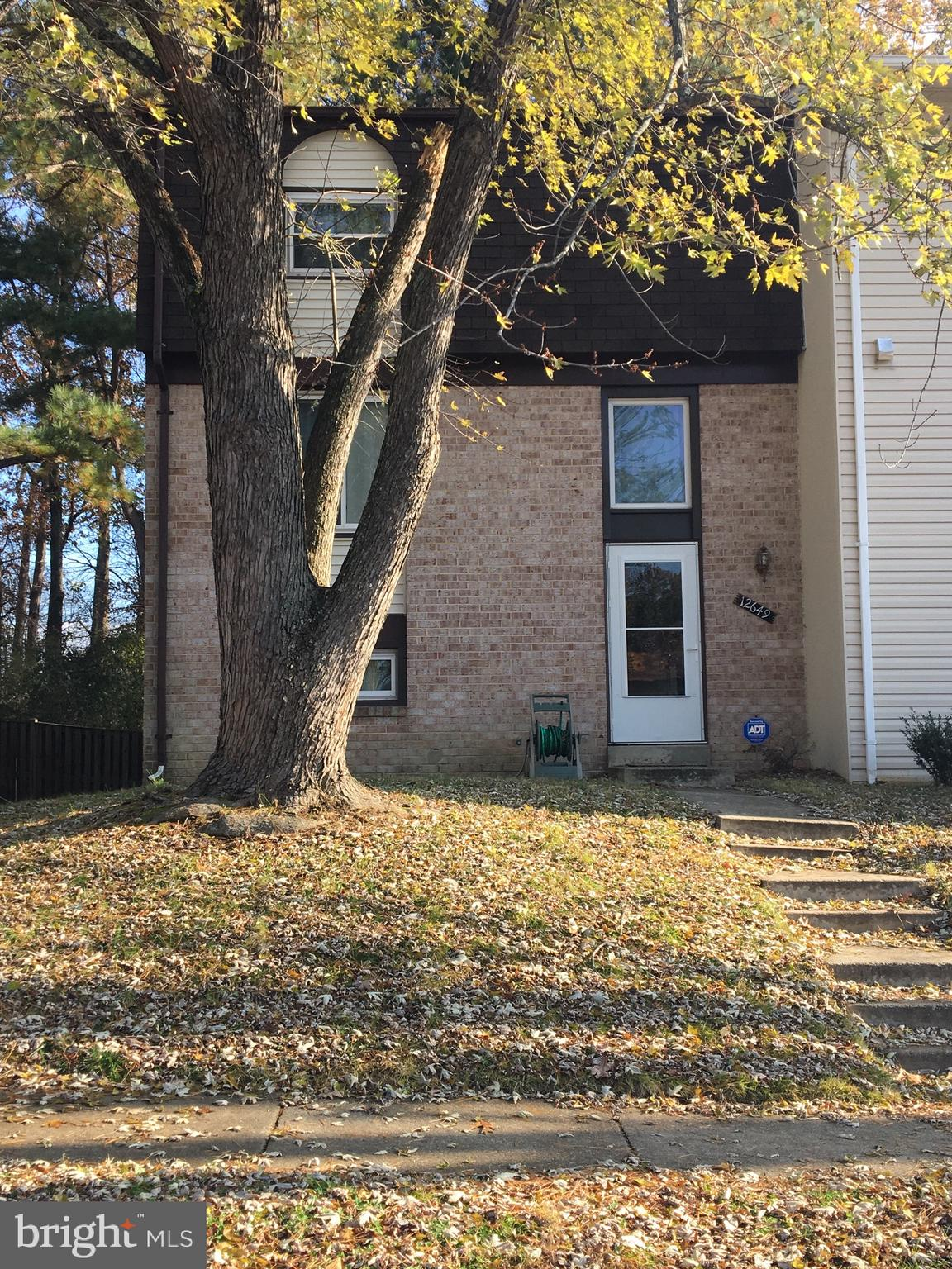 Lovely and cozy townhome in Lake Ridge with lots of updates. 2013 roof, Cherry Wood floors on the main level, new carpet in the upper floor and in the walkout basement, Kitchen was renovated in 2013, has cherry wood cabinets and tile flooring.  Features 3 Bedrooms upstairs and a room in the basement that can be used for an office or bedroom, full of natural light. Fenced large patio. Well kept!  Close to main road and shops! Pictures will be updated by Sunday. Agent related to owner