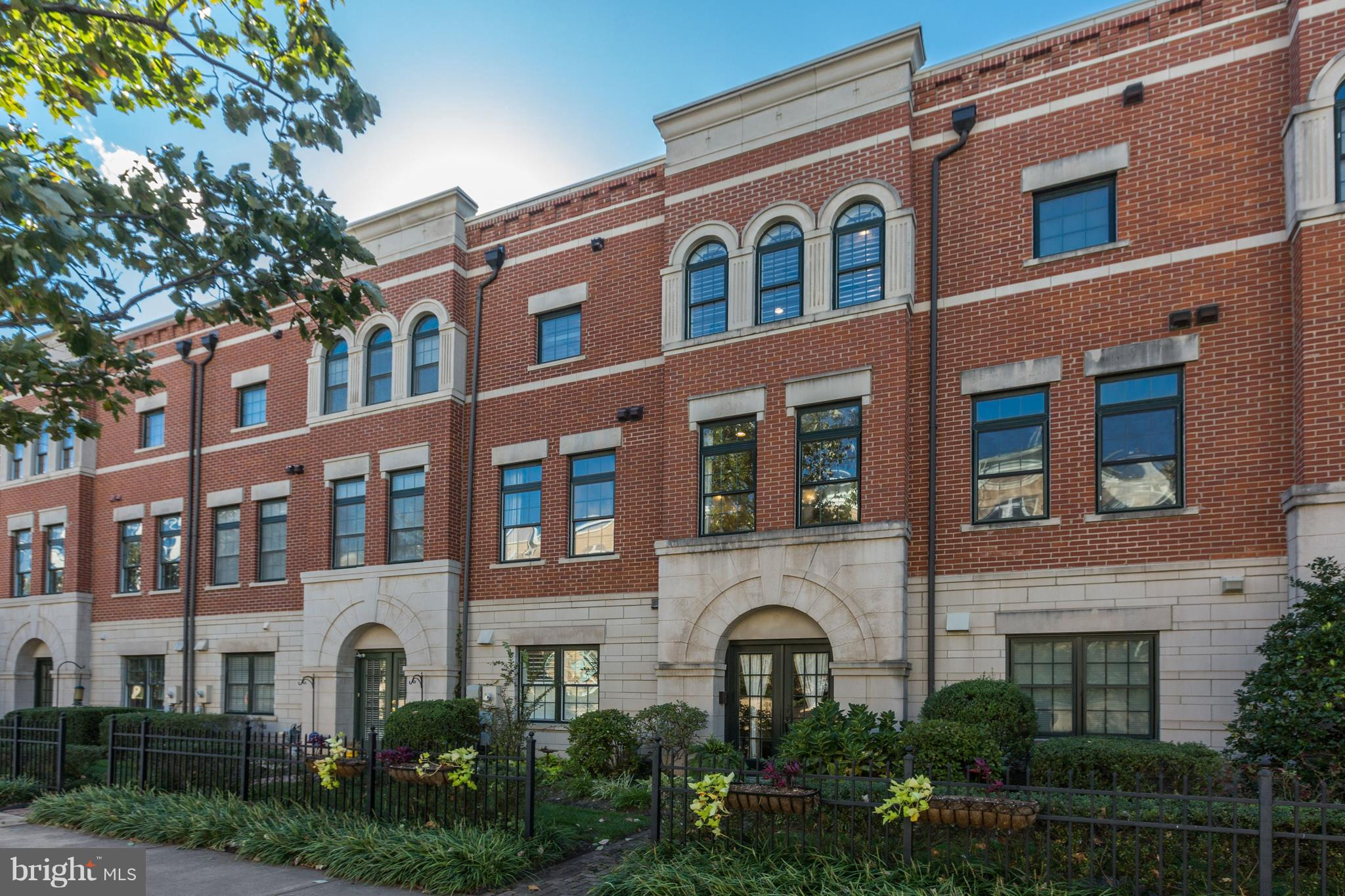 Stunning townhouse with loft and rooftop terrace across the street from Reston Town Center! Hardwood flooring, High-end Viking and Bosch appliances, custom-cut plantation shutters, new roof, HVAC, and carpeting (including custom-cut rugs for family room/other spaces). Two gas fireplaces, including one in the sitting area of the master bedroom! This property is immaculate and completely move-in ready!  Take advantage of all Reston Town Center has to offer, right outside your front door!  Metro stop will be a half mile down the street!
