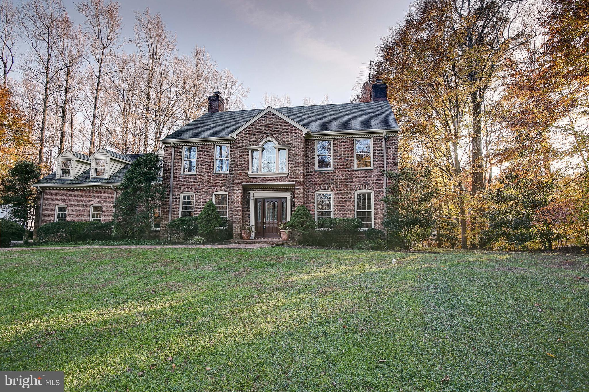 Stunning, Brick Colonial on 5 Acre Private Treed Lot in Equestrian Neighborhood. Featuring a Gourmet Chef's Kitchen w/2 JennAir Stoves, 2 Dishwashers, Recessed Lighting, Granite Counters, Plenty of Cabinet and Counter Space, Bar, & Wood Floors. Separate Dining Room and Living Room, Each w/Their Own Fireplace. Fabulous Yard w/In Ground Pool, Huge Patio, Tennis/Basketball Court. Entertainers Delight