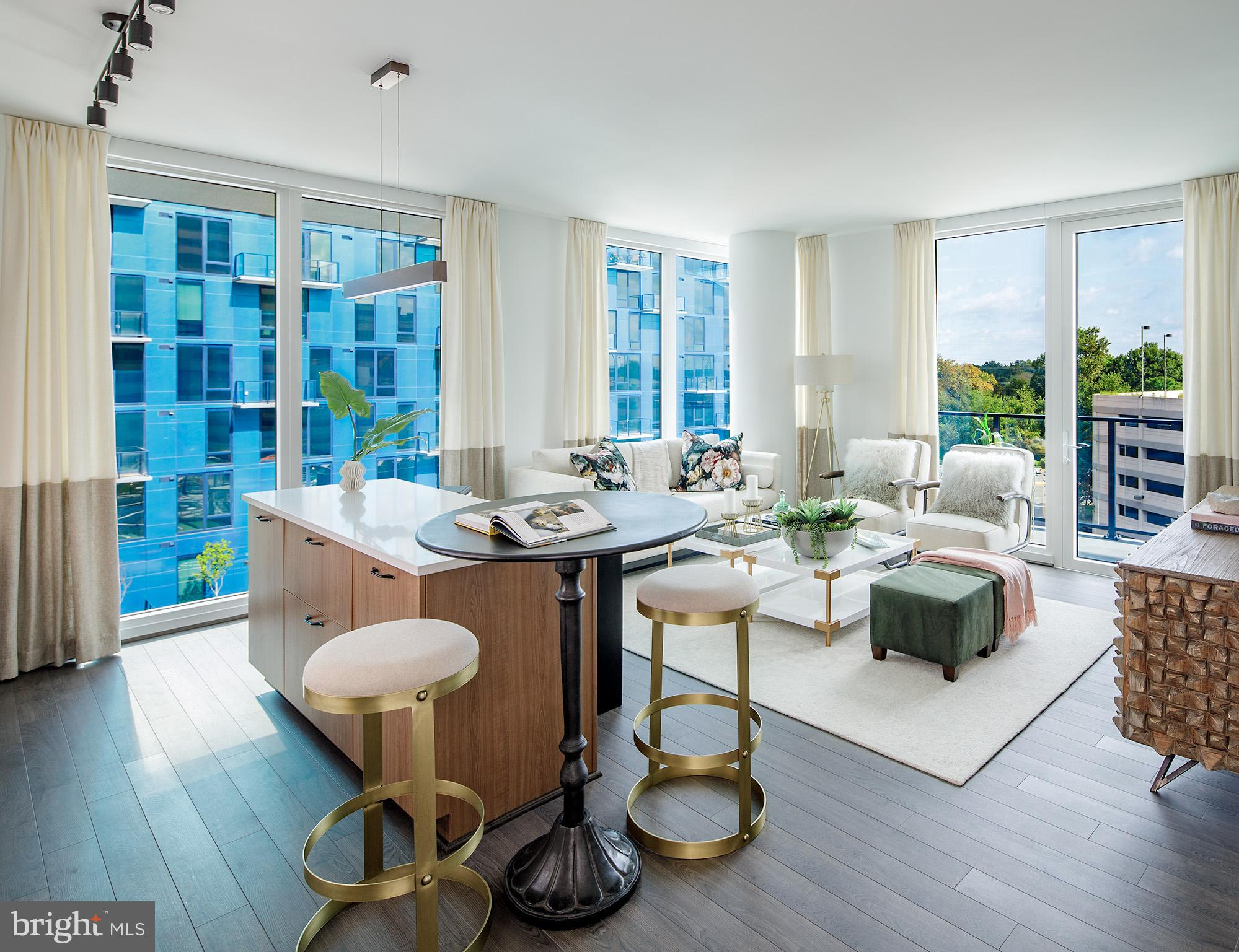 Say hello to brilliant living at Exo, kaleidoscopic Reston residences that light up your lifestyle. Embrace the spectrum of options with a vibrant mix of perks ~ including a meditation lawn, a vast pool and grill area, two premier penthouse lounges, and the world~s first residential building with View Dynamic Glass installed in every apartment. Vividly appointed with forward-thinking finishes that let you shine, Exo~s sophisticated homes let you to live in full color.
