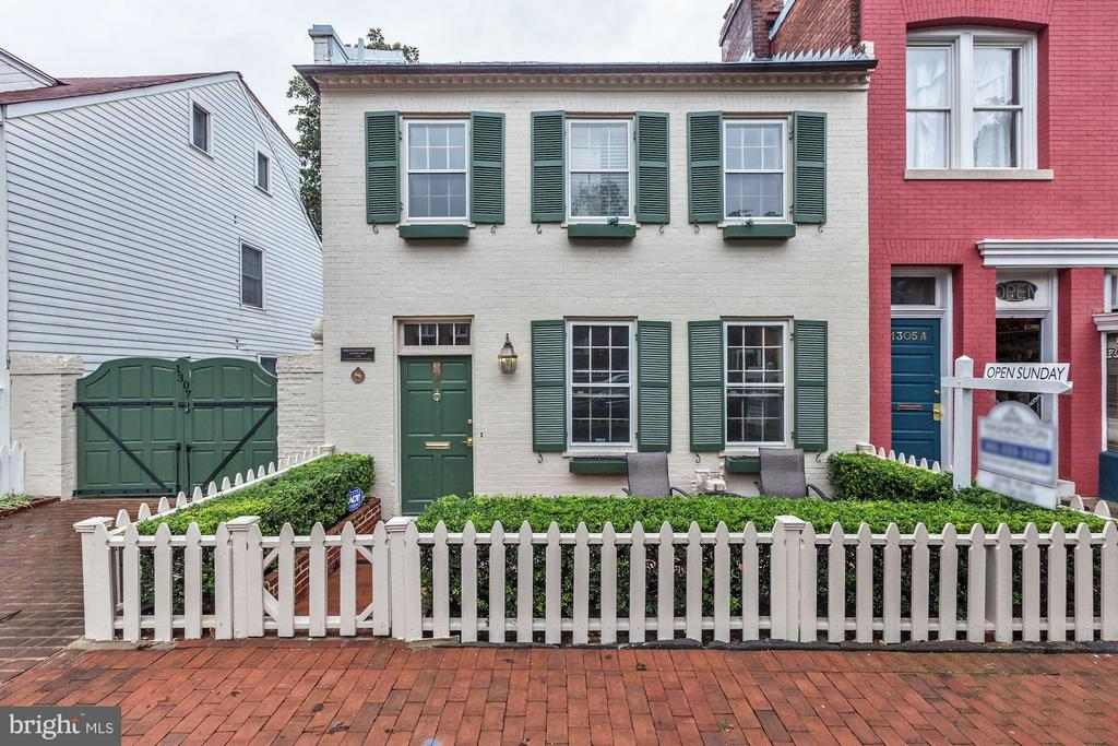 Historic & Charming! 2-car parking & huge garden. Entry level with living room, family room, as well as a bonus room. Lower level with gourmet kitchen & dining room with fire place, full bath, & walks out to patio & garden. Top level boasts 2 bedrooms & 2 full baths, master has a large dressing room. Close to the shops and restaurants of Georgetown, as well as the University.