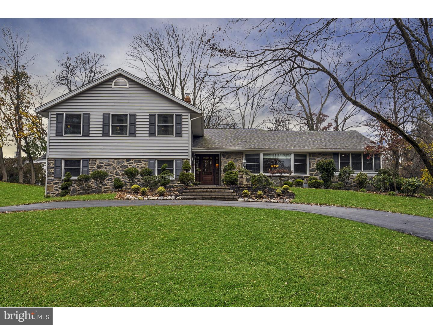 Totally renovated 4 level home that sits at the end of a cul-de-sac on a large lot adjacent to Radnor Valley and Overbrook County Clubs. You will be impressed by the circular (widened) driveway with column lighting and the paver pathway leading to covered front entrance. Open the Mahogany beveled glass door with side lights into the open foyer with glistening hardwood floors. The living room features recessed lighting and custom moulding that leads into the intimate dining room with coffered ceiling and wainscoting. The dining room is open to the sun room with access to the office. The beautifully renovated Kitchen, with cream colored raised panel soft closet cabinetry, offers a wet bar and glass top cabinets, ceramic tile flooring, glass tile backsplash, stainless steel appliances, large breakfast area and an outside exit to a paver patio. The lower level features a   23 x 15 family room with wood burning fireplace, slider to a second paver patio, powder room, laundry room with access to the garage and the partially finished basement with high ceiling. The second floor features a Master Bedroom suite with his-and-hers walk-in closet, new luxurious bath with double bowl marble topped vanity, Yorktown cabinetry, and a marble shower with rain head and frameless glass door; Three additional nice-sized bedrooms with access to the black-and-white tiled hall bath with double bowl granite topped vanity and soaking tub. So many additional superior upgrades have been recently performed including: raising the height of the family room ceiling, custom millwork and mouldings throughout, Whole house Generac Generator, oil rubbed door hardware throughout, wide trim throughout, new HVAC, Pella Windows, widened and extended driveway with rustic column lighting, paver walkways and patios, attic insulation and so much more.