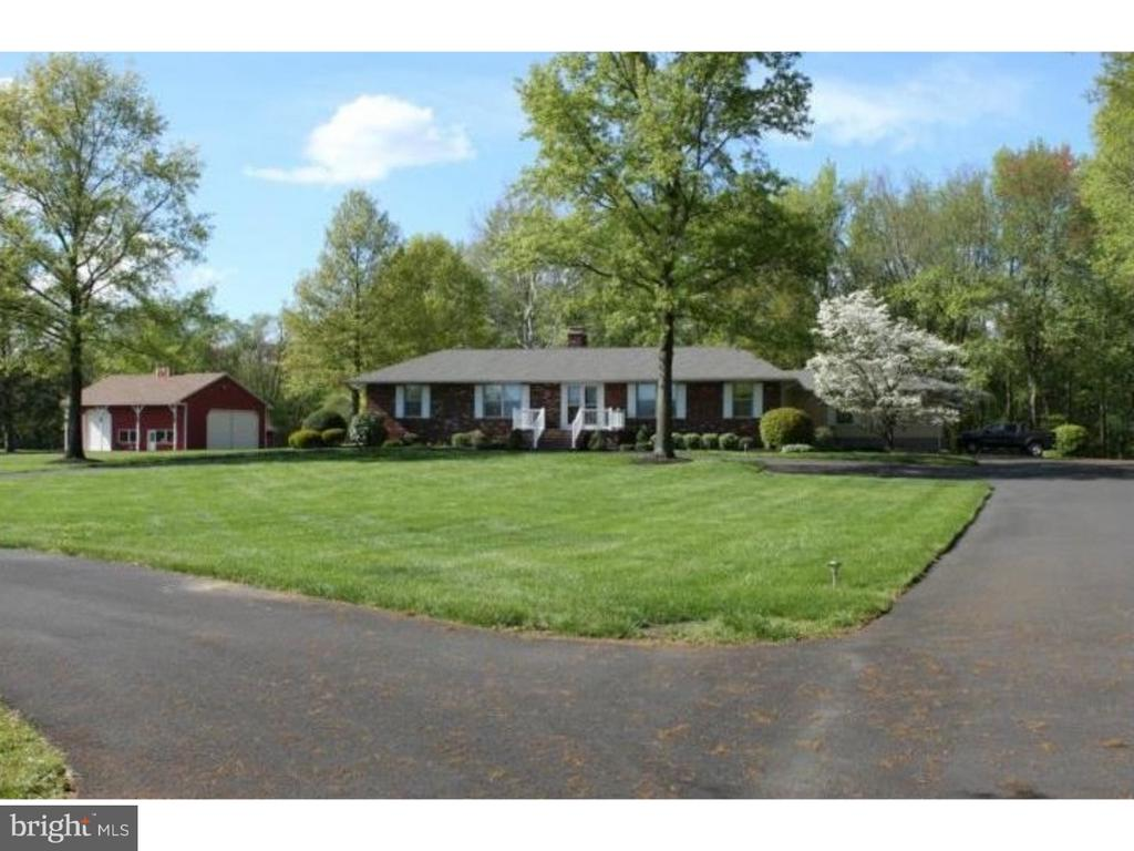 """This beautiful custom built Ranch home sits back 1200 feet from the road on a mature tree lined black top driveway that overlooks farmland with plenty of privacy and has a licensed Heliport that is transferable.  (Bring your helicopter)   This beautiful home which is meticulously kept looks new and boasts' newer hardwood flooring throughout. The Great room has a full brick fireplace with propane logs for a warm cozy feel.  The large country Kitchen has recessed lighting, wood cabinets, new appliances, glass cook top, ceramic tile backsplash, and solid surface countertops with stainless steel sink.  Dining room has windows overlooking the view of acres of open farmland. There are 3 spacious bedrooms; the master bedroom has 2 walk-in closets and also a great view of both the front and back of property.  There is an office for your personal use, a huge full finished basement with a brick, wood burning fireplace, pool table, ping pong table and open area for entertainment.  The exterior back has a deck with railing and walk way connected to your own personal Gazebo.  The rear yard includes a large barn/garage, approximately 2100 sq. ft.  with 16 ft. ceilings and 14 ft doors to store a Helicopter , Motor Home, boat or whatever you see fit. The electric on this entire property is all underground. A second well was installed (2017) in front yard for use in field, irrigation, barn, horse pasture, etc. This home is truly one of a kind, surrounded by nature, much privacy and is waiting for new owners.  Bring your horses!  This is a """"must see"""".     Must call for appointment to see this amazing property and possibly your future home!  (ask about adjoining 20 acres)"""