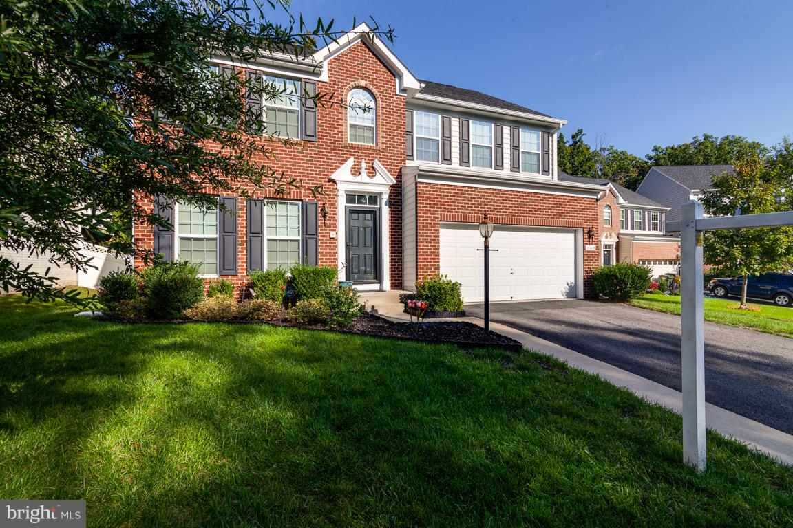 Like new 4BR/2.5 BA, 2-car gar; 6 yrs young! COLGAN HS! One owner home on quiet cul-de-sac surrounded by trees. Gleaming hardwood floors on main level, new carpet, fabulous kitchen w/ granite counters & stunning cabinets. Finished space in basement incl huge rec room w/ study/office cubby; 2 add'l unfinished rooms & rough-in plumbing. Gorgeous $15K stamped concrete patio perfect for entertaining.