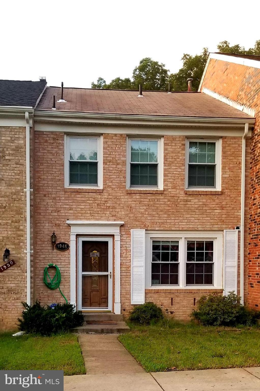 Well kept brick front TH less than 2 mi. from I95, rt.123,close to shopping. Convenient Commuter location! 3 Finished levels. 4 BR, 3 1/2 Baths. Independent walk out Basement to spacious Flagstone, Fenced Patio backing to trees. Hardwood Living Rm, Ceramic Foyer, eat in Kitchen & Dining room.3 BR, 2 full ceramic baths upstairs. 4th BR, 3rd Full Bath & Rec Rm in Basement. 2 assigned parking spaces.