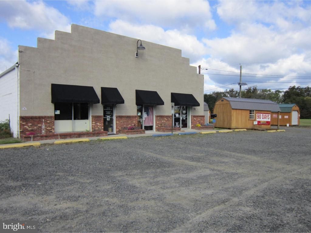 Two one Story Buildings (5,000 sq. ft. each) on well and septic, both  buildings currently occupied, along with a Cell Tower tenant! Property Zoned Highway Commercial and Town Center (SF and Twins permitted) 1,285 foot frontage on US Highway Route 206 (Traffic controlled intersection) and 1,100 foot frontage on Pemberton Road (Co. Route 616)- 20,000 ADT (Average Daily Traffic). Public water and sewer NEAR site!  Make your appointment today to view property.