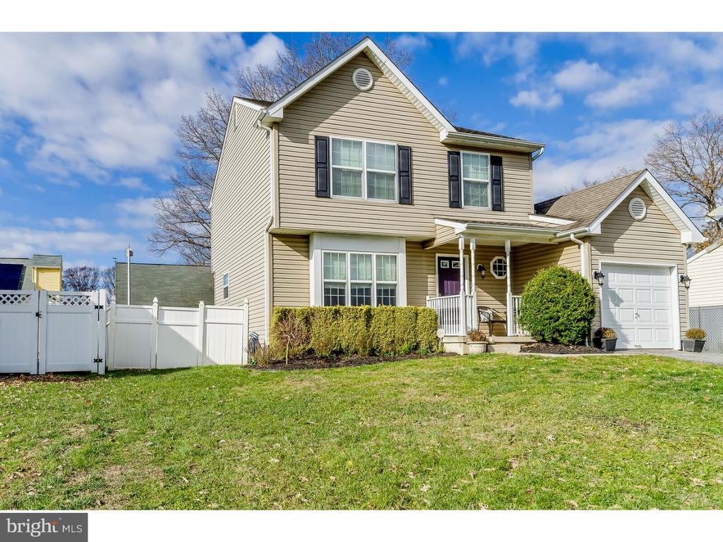 Stunning two story home in turn key, move in condition. You will appreciate all of the amenities this home has to offer - laminate floors throughout and and a spacious entertaining area. There is a cherry wood handcrafted wet bar with granite counter tops and under mount sink - you must see it to believe it! Newer features include a tank-less water heater (2 Years), newer AC unit (2012), gutter guards(2 years) and fully floored attic area with pull down step access. There is a fully fenced rear yard and a new cedar shake siding shed (16 x 12). See the new sliding glass door with center foot lock for additional security and the newer side door with dead bolt lock. The master suite features cathedral ceiling, walk-in closet and en-suite bath. All this and a one year home warranty too!!