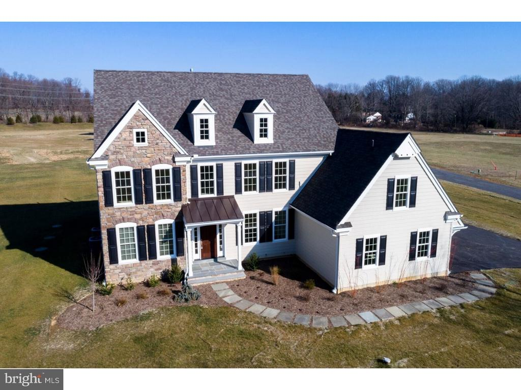 """Introducing Bechtel Farm... 7 custom estate homes to be built by Hellings Builders. Each homesite is flat and over an acre and yet so conveniently located just minutes from shopping and major highways. The Merion model features a chef's kitchen with 42"""" cabinets, furniture style island, granite counters, stainless steel appliance package, and pantry. The great room is open to the kitchen with a wall of window and fireplace. A classic dining room, flex room which can be used as a formal living room/office/bedroom/playroom, a powder room and mudroom with garage access complete this model's spacious first floor layout. An oak staircase with painted risers leads to the upper level and the luxurious master suite with dressing area, dual walk in closets and a lavish master bath with soaking tub, his and her vanities and private commode. Why do we LOVE Hellings Builders? Quality craftsmanship, trusted materials, the ability to customize and hands on involvement with the owner of the company. Plus work with Z Domus Designs to design your interior! Yes - an insanely talented interior designer will help you with your decorator options! Additional highlights of these breathtaking homes include site finished oak hardwood flooring, crown molding, chair rail, arched opening in the elegant foyer, professional landscaping, and a convenient location just minutes from major employment centers and world class shopping. Please note photos are of a similar, completed model which may reflect additional upgrades and finishes."""