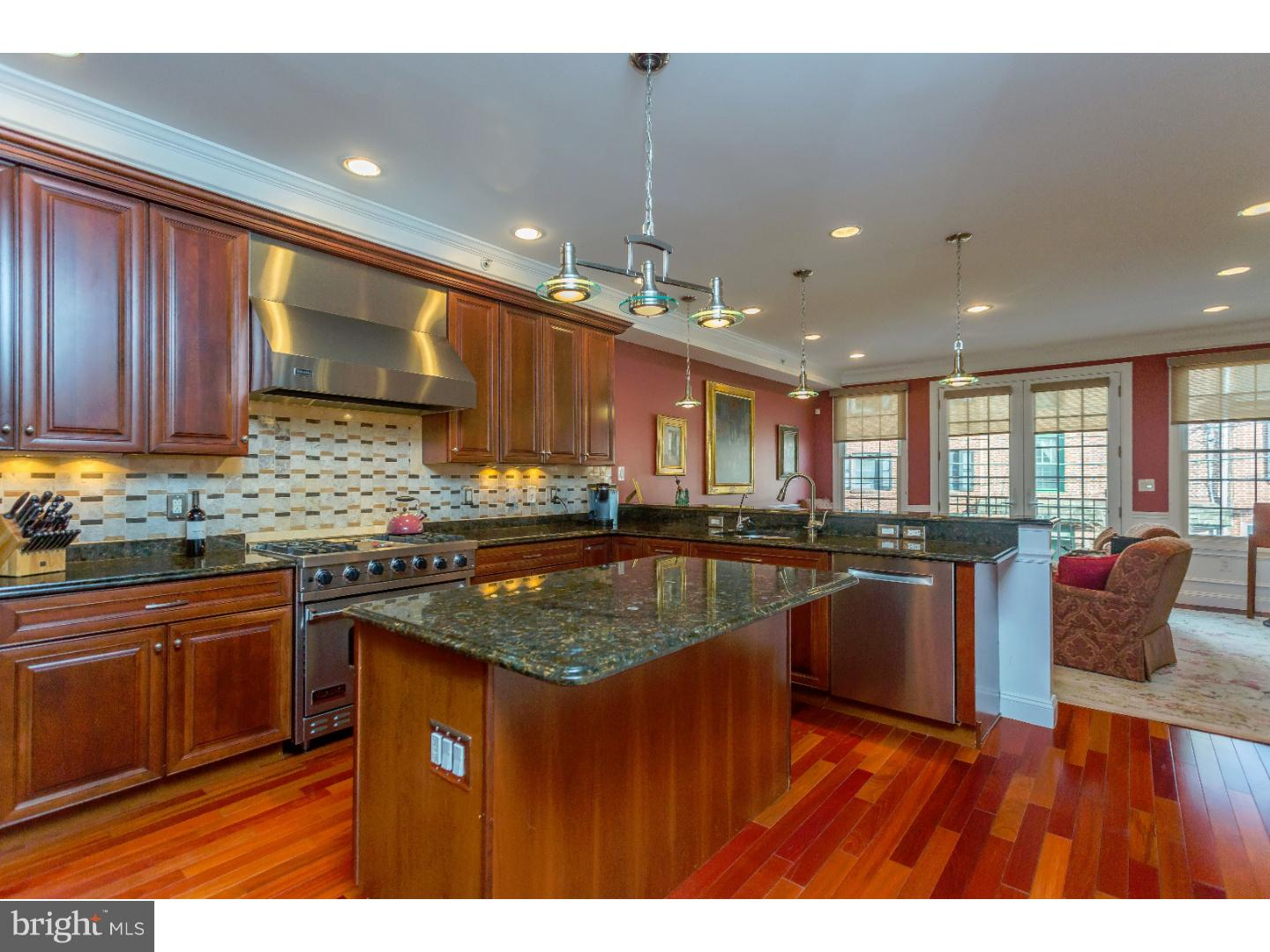Three bedroom plus den, 4 1/2 bath 3300 plus sq ft home with GARAGE PARKING, and ELEVATOR is now FOR SALE in the heart of Queen Village. This sun splashed residence boasts a fantastic second floor with off the charts living, and dining area. All open kitchen with GRANITE counter tops, HIGH end stainless steel appliances, island, and HUGE breakfast bar; all over looking a warm, and romantic living area with Juliet balcony and wonderful Eastern Exposure. On this level, you will also find a FORMAL DINING ROOM, with French doors leading out to an enormous deck. A wonderful extension of your living space 6 MONTHS out of the year. Third floor consists of two very well proportioned bedrooms, and two additional large MARBLE and TILE baths. Your Master suite level is AWESOME! Incredible master bedroom suite with fireplace,  PRIVATE deck, enormous MARBLE bath with double sinks, glass shower, and WHIRLPOOL TUB. For the clothes lover, there is a very large WALK-IN closet. With HARDWOOD floors throughout, ELEVATOR running from your finished basement to Master Suite , all important garage, plus additional in home office/den with full bath, and the third outside space, makes this GRACIOUS and SPACIOUS home a MUST SEE!