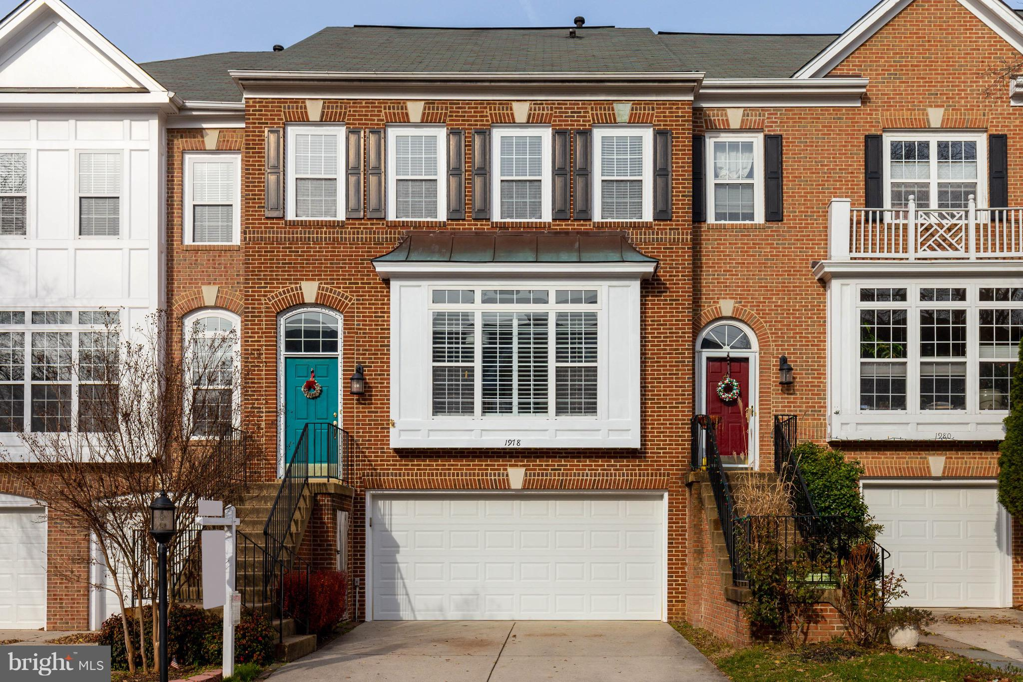 Fabulous, 4 bedroom, 2 car garage at the Reston Town Center.   Welcome to this light filled, spacious home.   Bump out extensions on all three levels make this home truly unique.   Wide planked, maple hardwood floors grace the main level, staircases and upper foyer.   The living room boasts custom bookcases.   Gourmet kitchen features stainless steel appliances, gas cooking, granite countertops.    breakfast bar and dining table space.   Cozy up by the fireplace in the family room, just off the kitchen.  Great Trex deck off the family room.   Large master bedroom with extension, perfect for sitting room, home office or exercise space.  Remodeled master bath with soaking tub and separate shower.   Vaulted ceilings in all three upper level bedrooms.   Upstairs laundry.  Fully finished basement with fourth bedroom and full bath.  Plenty room for entertainment.   Access to stone patio.   This home is complete.  Move in, relax and enjoy!!
