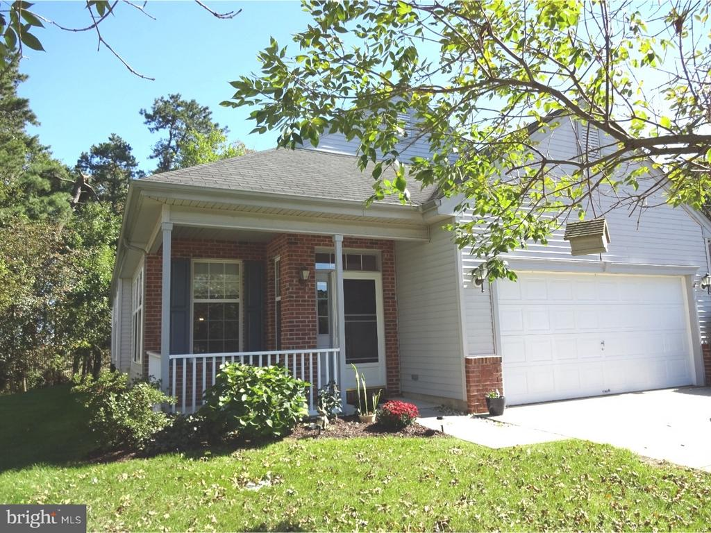 Location!!  Location!!  Welcome to this great, popular Kenwood W/Loft w/Brick accents, 2 Car Garage, GAS Heat, Range and HWH.  This home has been lovingly maintained!  It's located on a large  Cul-De-Sac which is within walking distance to Laurel Hall, one of the Clubhouses in LeisureTowne where most activities are held and 1 of the heated swimming pools for next summer.  Notice this home's fabulous Covered Front Porch for those relaxing days.  This great home has an open Living/Dining Room concept.  Steps away is the Hub of the home, you will enjoy using the well designed Kitchen w/Maple Cabinetry with extra cabinets storage galore, and, an Island w/Overhang for seating.  The adjacent Family Room has a cozy GAS Fireplace w/Cream Marble Surround.  Can you imagine enjoying the cozy Fireplace while dining, watching TV, or entertaining?  The French door leads to the Patio and the wonderful Backyard w/private views of picturesque nature.  During the winter there are spectacular views of the cranberry bogs beyond and from the Loft window also.  The spacious Master Bedroom is comfortably sized for a king sized bed which fits easily with plenty of room for dressers and even a relaxing chaise lounge.  There's a Walk-In Closet as well as a Double Closet.  The Master Bath has Dual Sinks for convenience and a roomy Double Stall Shower.  Bedroom 2 is also very spacious.  The Hall Bath is located within steps for your overnight's guest's convenience.  Notice the hallway is extra wide.  The Loft will offer extra living space for you to be used as an office, billiard's room, crafts/hobbies or just reading a book. As you enter this great home from the 2-Car Garage, the Laundry/Mud Room will come in handy on those wet weather days.  There's a Utility Sink which will come in handy for many things. The home-site is extra wide as it's located on a curve which gives extra space between the homes.  There's also an extra Closet in the Hallway for more storage.  The Living/Dining Rooms hav
