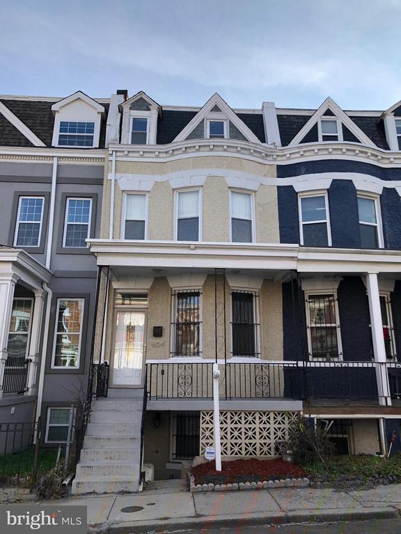 WONDERFUL OPPORTUNITY TO OWN AN INVESTMENT PROPERTY OR LIVE ON THE TOP LEVEL AND KEEP THE TENANT BELOW. PROPERTY HAS BEEN METICULOUSLY MAINTAINED AND FULLY RENOVATED. FRESHLY PAINTED. THREE BEDROOMS ON THE UPPER LEVEL AND THREE FULL BATHS. COO ONE-BEDROOM UNIT IN THE BASEMENT. FULLY RENOVATED. SEPARATE METERING.  WOOD FLOORS ON THE UPPER LEVEL UNIT. SMALL CAR PARKING IN REAR. 4 BLOCKS TO COLUMBIA HEIGHTS METRO.