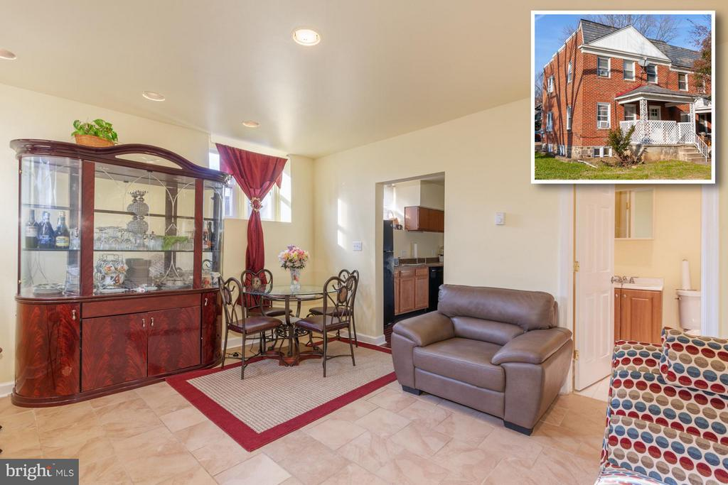 LEGALLY ZONED 2 UNIT ROWHOME WITH OFF STREET PARKING! Located minutes from the heart of downtown Catonsville, this end of group rowhome features 3 finished levels consisting of two 1 bedroom apartments w/ living rooms & kitchens. Separately metered and move in ready! Perfect opportunity to live in one unit and rent out the other unit to help pay your mortgage or perfect for an investor looking to add to their rental portfolio!  SOLD AS-IS!  SELLER WILL MAKE NO REPAIRS!