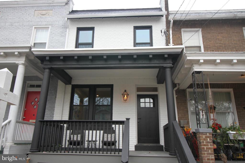 Completely renovated Gem in brookland.  Well placed 3 beds plus den. Walk to what Brookland and 12th have to offer.  High end beautiful white kitchen with a large deck off back.  Amazing master bedroom with a private balcony.  2 Beds and Den on Upper level. Excellent in-law suite in the basement with electric cooktop and private entrance.  Off street parking and fully fenced back yard.  This will not last!