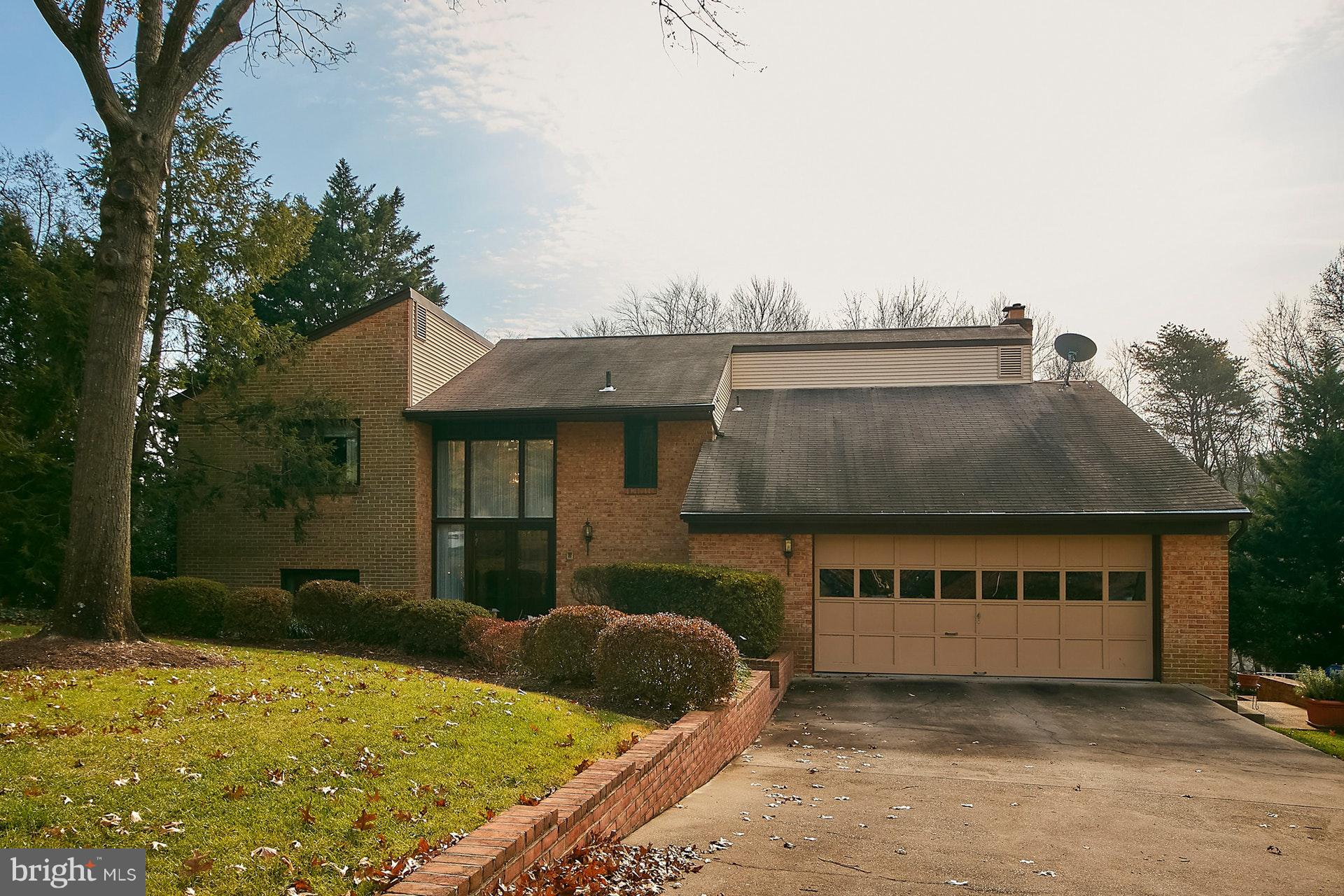 Wonderfully large and bright contemporary on a beautiful .5 acre lot in the desired neighborhood of Wilton Woods. The renovated kitchen includes stainless steel appliances, granite counters, tile backsplash, and double sink. It also has a built-in workspace and eat-in breakfast area. Just off the kitchen is a large, comfortable family room with a gas fireplace, wet bar, and beamed ceiling. Both the kitchen and family room open to a large trek deck, great for entertaining. The deck includes a hard piped gas grill and an electronic awning. The first floor includes a large separate dining room and spacious living room. Just off the oversized 2 car garage you find a bright, spacious laundry room with built-in extra storage and new washer and dryer. The upper level includes a master bedroom suite with hardwood floors and 2 closets, one an ample walk-in closet. The master bath has dual vanities, separate shower, and a large soaking tub. The remaining upper level consists of 3 bedrooms, one with a walk-in closet, and hall bath with double vanities. The lower level will knock your socks off.  Consisting of a large bright rec room with 12' ceilings. It includes a gas fireplace, large wet bar with beautiful custom built-ins and beverage fridge. The rec room opens to a large screened porch with ceiling fans so you can enjoy summer nights without bugs. Also on the lower level is an office/bedroom with built-ins and coffered ceiling. There is also an additional bonus room that is currently used as a bedroom. Finally, the spacious utility room opens to a very large storage/work room that exits to the side yard. The back yard is flat and includes a serene view of trees. The HVAC system is a 2 zone system, main and lower have a gas forced air furnace and a/c(2014), the upper level is a heat pump. Water heater replaced in 2018. All of this and minutes to Crystal City, National Landing, BRAC, the Pentagon, and Fort Belvoir!